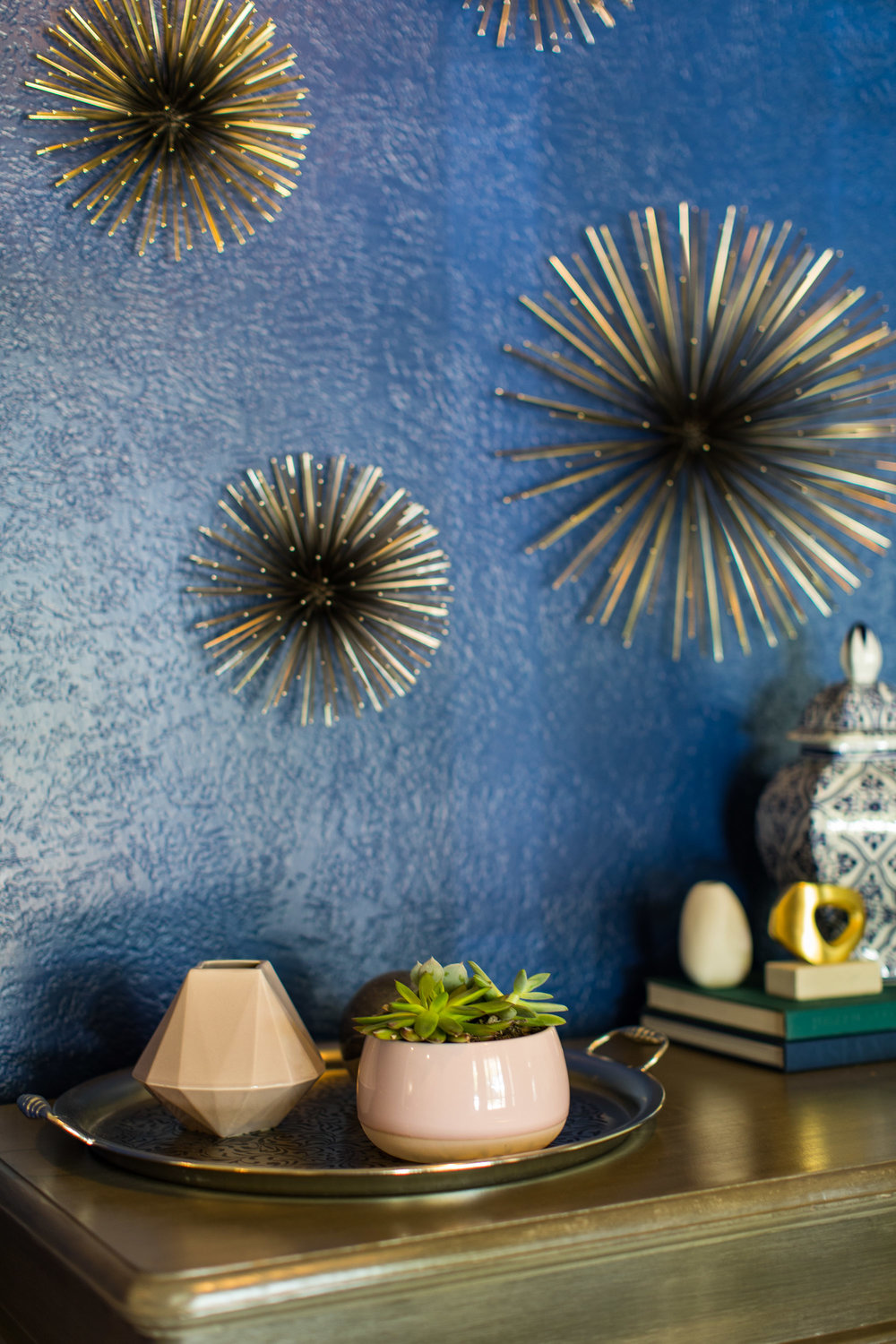 The entry way was a quick fix! I added metal urchins to the existing saturated blue walls and some fun table accessories.