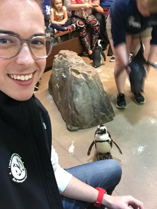 Cameron takes a penguin selfie at the Newport Aquarium in Newport, Kentucky