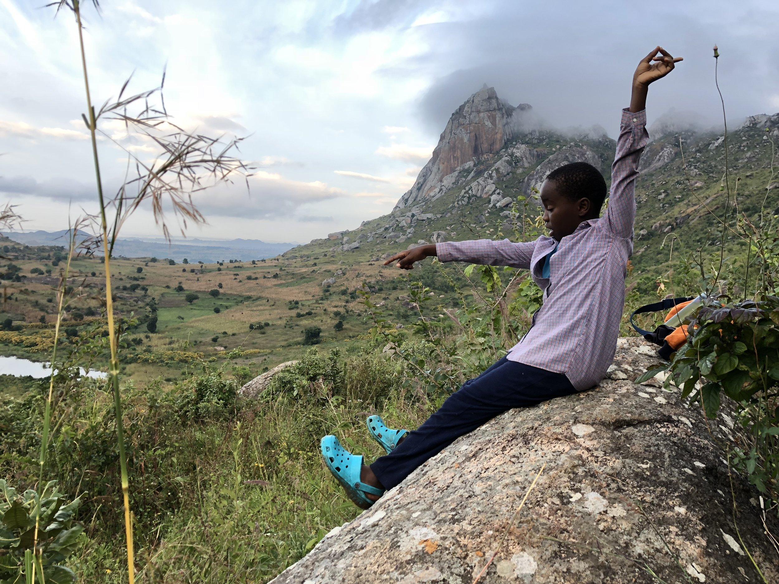 Mwenecho tells stories at the base of Mount Nkhoma