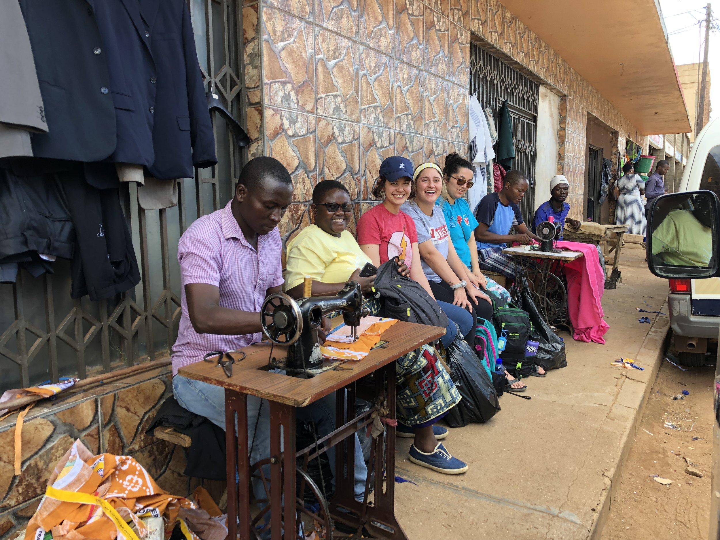 Nyathipa, Maggie, Karly and Sophia prepare fabric to make hospital blankets