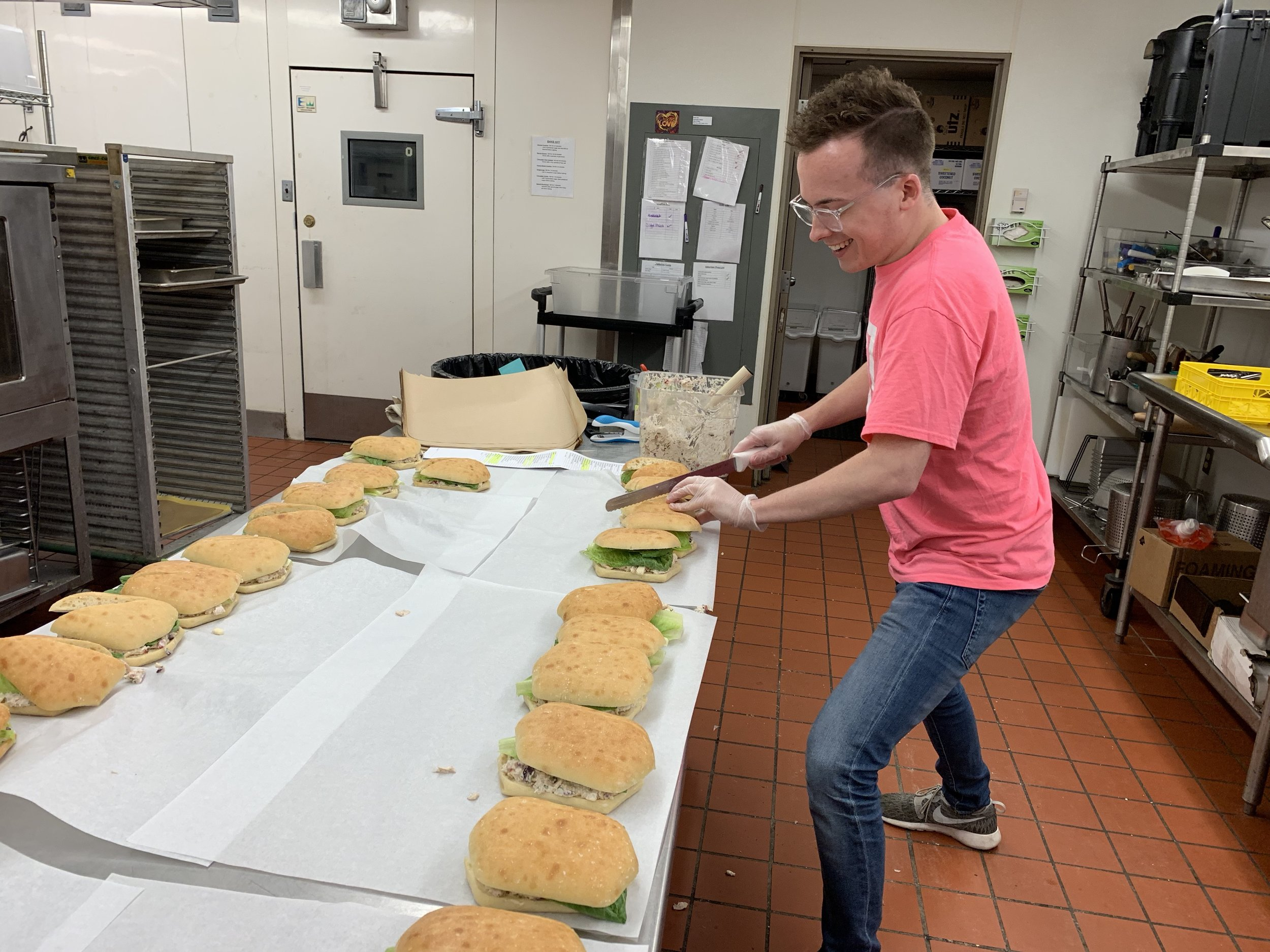Cameron prepares sandwiches in the Freedom a la Cart kitchen