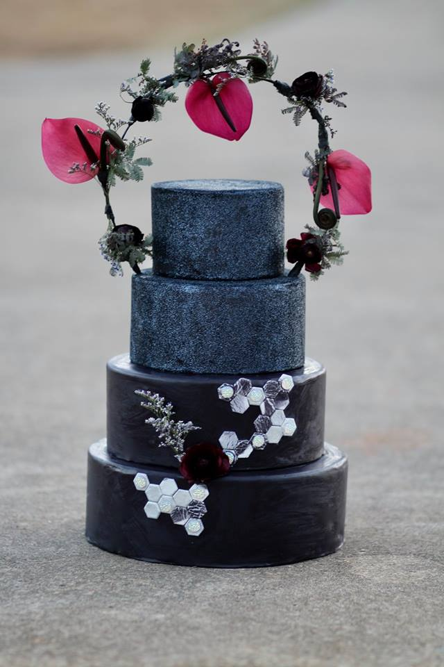 Brittney and Jon Grant - Another halo design, but this one with glittery black tiers and a modern geometric pattern.