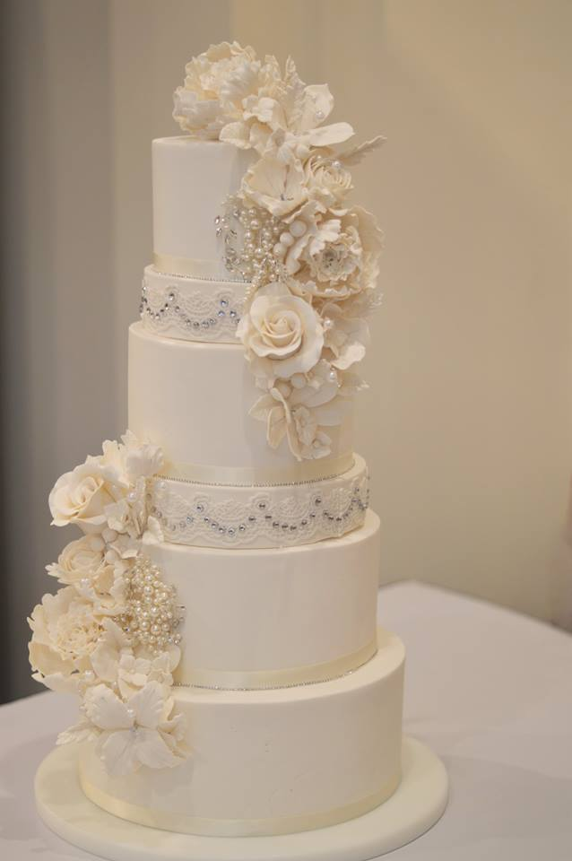 The Bride's Cake - A smaller version of the large cake was created for the bride. It featured 4 tiers of birthday cake flavor cake.