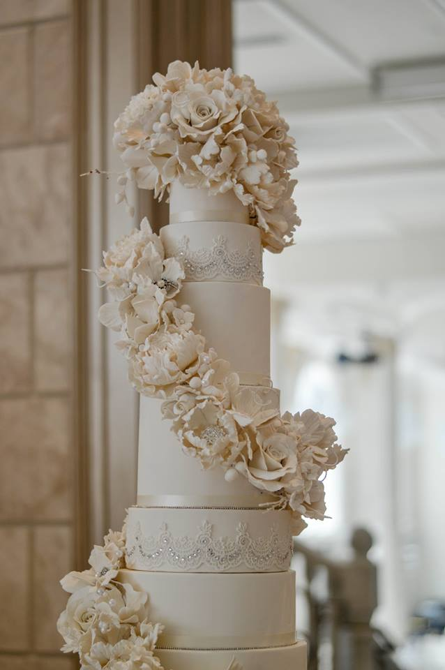 Floral Fantasy - The cake featured thousands of individually-crafted sugar-flowers, crystal-accented lace, and Swarovsky crystal brooches.