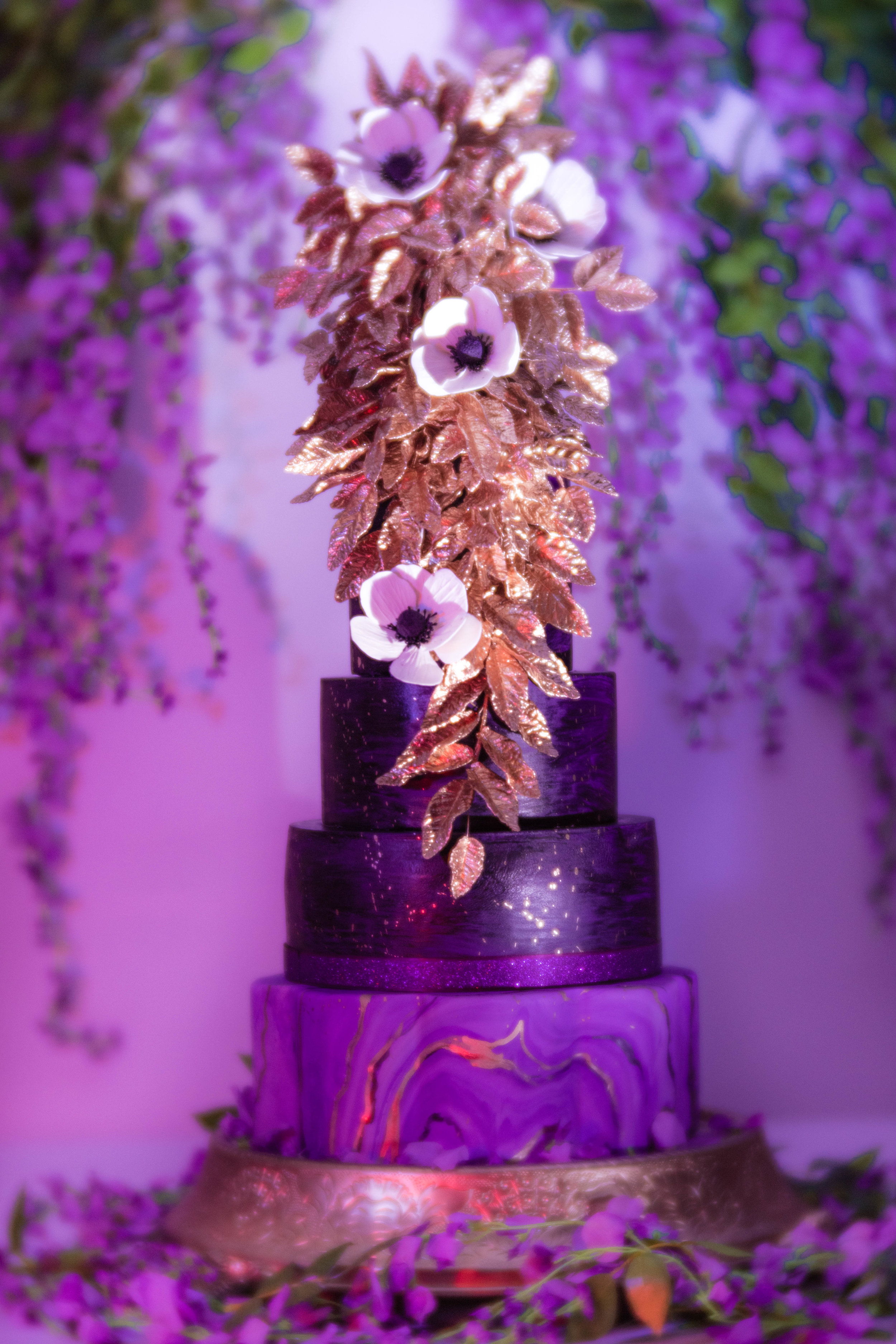 At the Venue... - The cake was bathed in purple light for a very dramatic centerpiece.