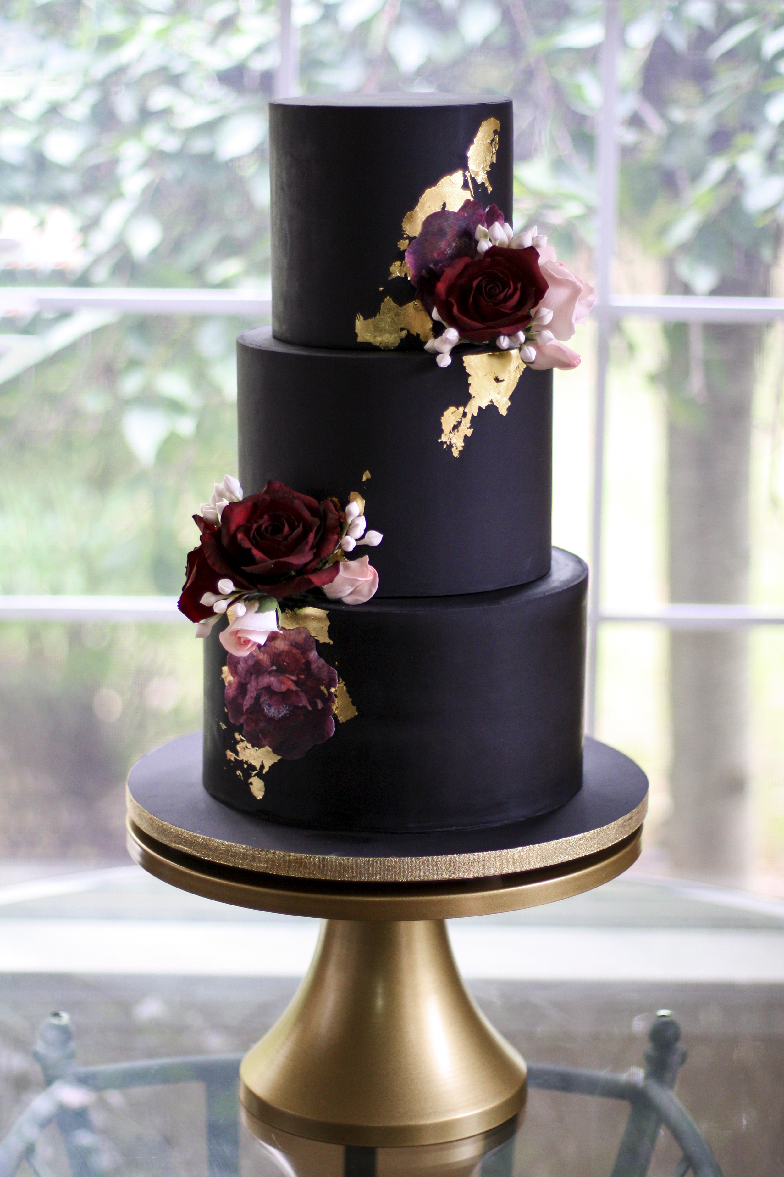 Nisha Fernando, Sweet Delights Cakery - Seriously sophisticated, this all black design with magenta, and deep-red sugar florals makes a huge statement.