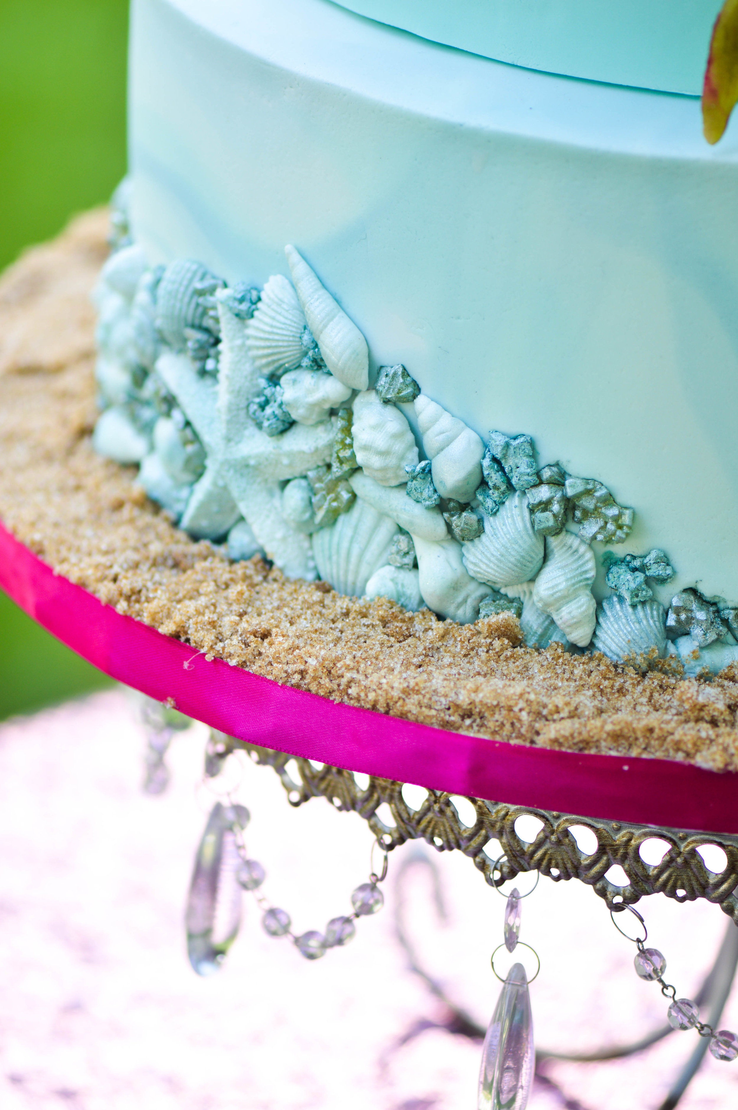 Sensational Shells - The bottom tier included a delicate bas-relief effect with edible sea shells and candy crystals.