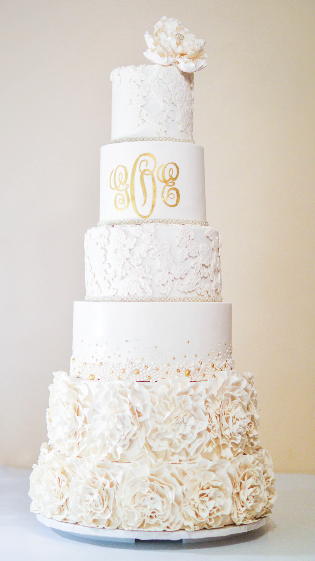 Mad about Monograms! - The cake featured four real tiers and two faux tiers which were adorned with layers of sugar ruffles.