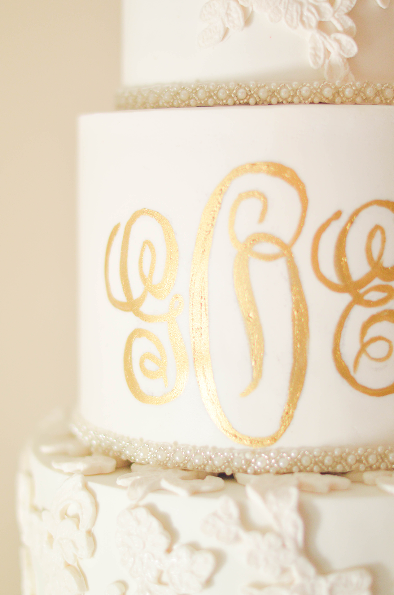Gold Romance - The monogram was hand-painted with edible gold luster dust in a fancy antique script.