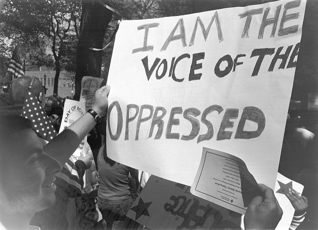 """"""" I Am the Sign of the Oppressed """" by  Doug Geisler  is a Creative Commons image, licensed under  CC BY 2.0"""