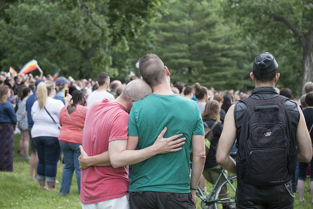 """"""" A Couple at a Vigil to Unite in the Wake of the Orlando Pulse Shooting """" by  Fibonacci Blue  is a Creative Commons image, licensed under  CC BY 2.0"""