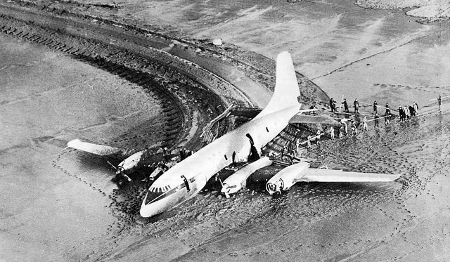 """A quick-thinking pilot landed his crippled and burning airplane in the Severn Mudflats (UK), averting disaster; no one was seriously injured — """" Landing on Severnside Mud """" by  Paul Townsend  is a Creative Commons image, licensed under  CC BY-SA 2.0"""