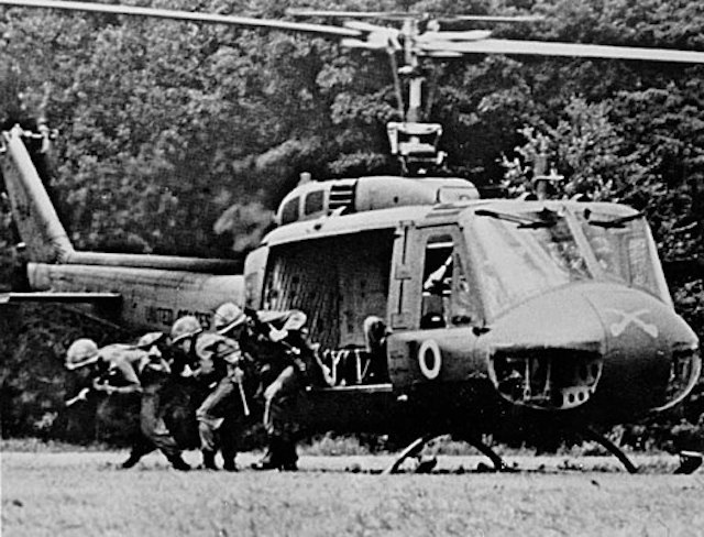 """"""" Infantry 1–9 US Cavalry Exiting UH-1D """" by US Army Photo is a public domain image"""