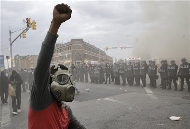 "Baltimore erupted in protest in April 2015 after Freddie Gray died in police custody — "" bpd12 "" by  SCUBACOPPER  is a Creative Commons image, licensed under  CC BY 2.0"