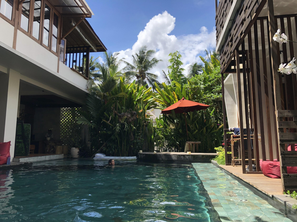 The main pool at Kakul Villa, with rooms dropping down directly into it.