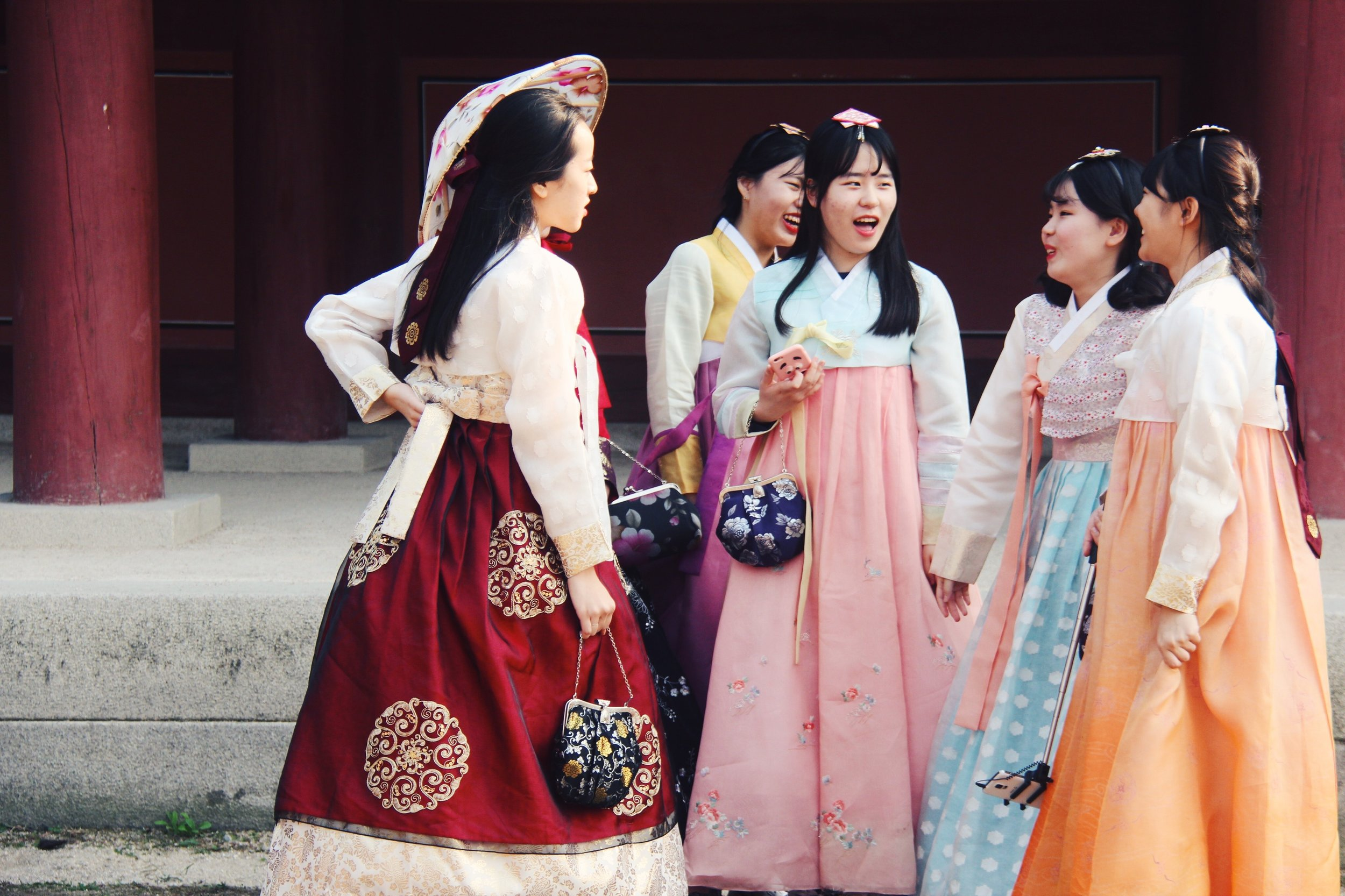 Young girls in rented hanbok enjoy their time at Gyeongbokgung.