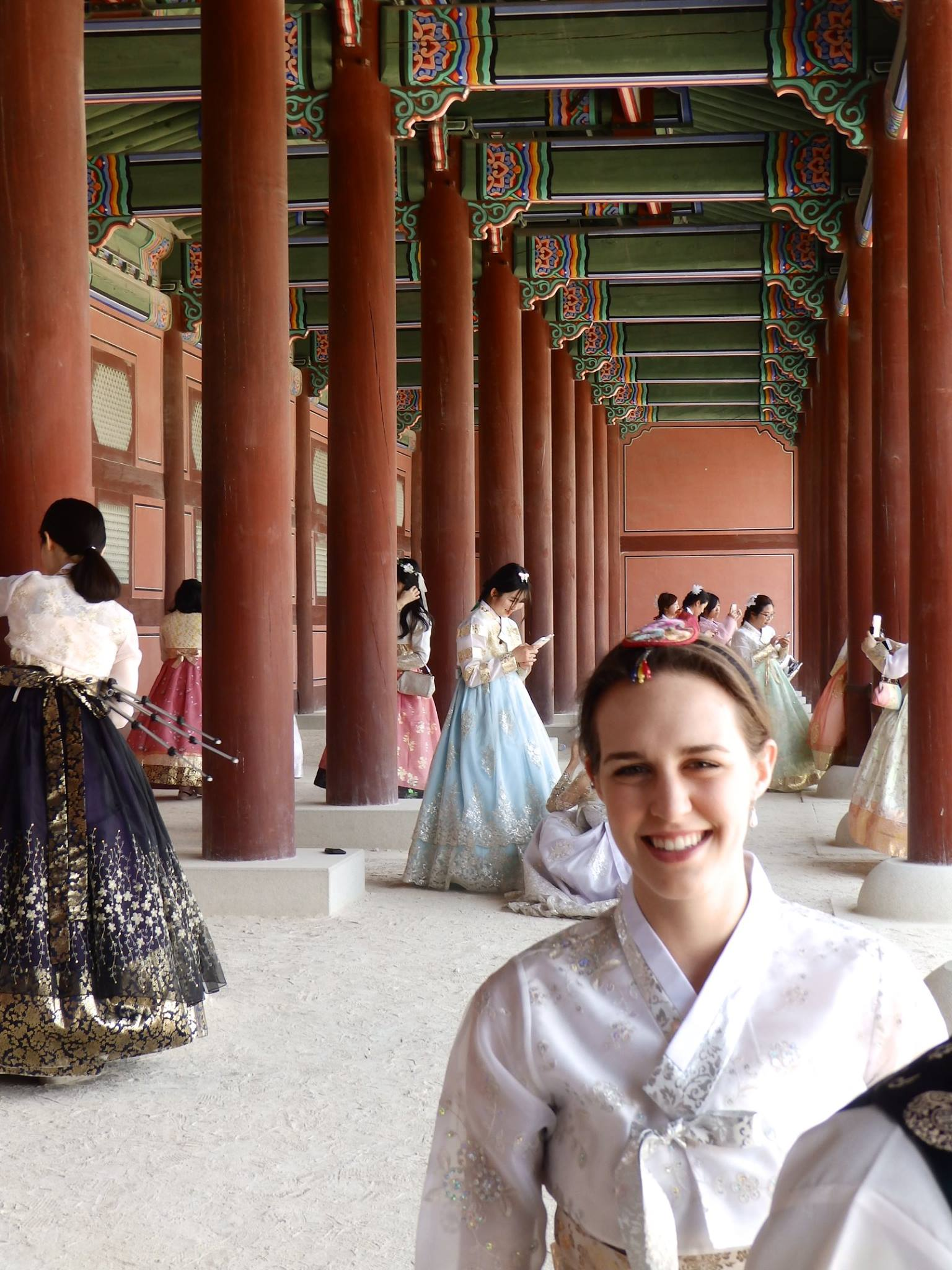 Myself in Hanbok and a HORDE of Korean girls taking cute photos at the grand palace in Seoul.