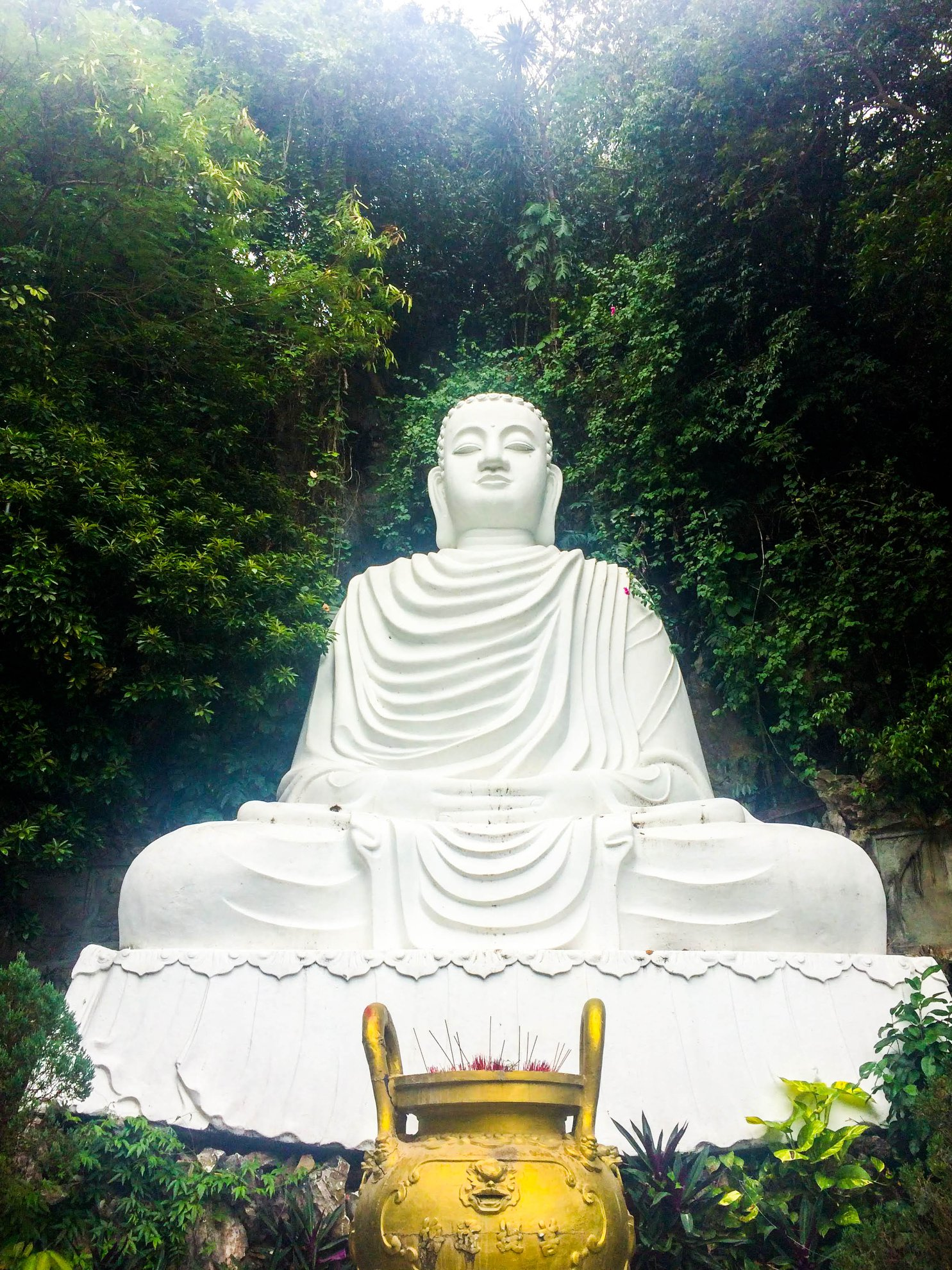 "This one is not the centerpiece of a sanctuary, and had a sign explicitly allowing photographs. You can get your amazing Buddha shot and still be respectful. Shout out to Vietnamese humidity for giving him that ""ethereal glow""."
