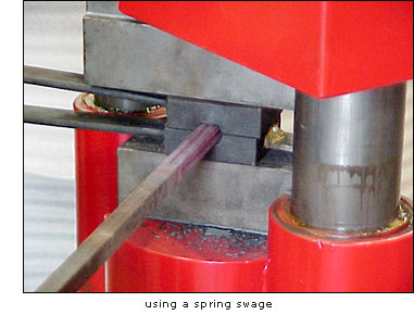 The KA hammer will clamp and hold stock for twisting. The down force of the ram is 500 PSI at 100 PSI of input air. Spring tooling is used to ornament stock before twisting to give complicated effects like rope or wood grain.Forge welding is a stumbling block for many smiths as there is little time to position the hot material, drop the tongs, reach for the hammer and strike while the iron is hot. The KA hammer allows both hands to be used to hold the material while the weld is made. -