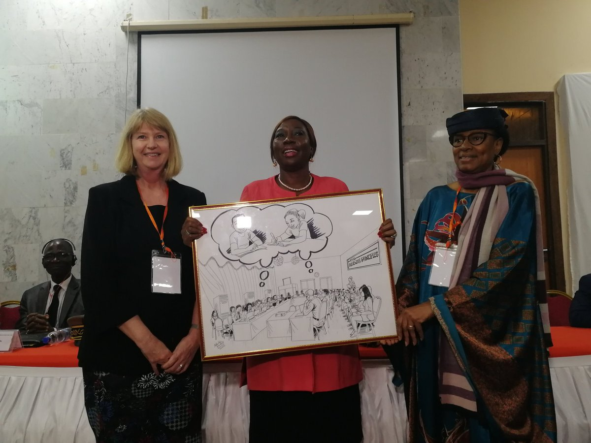 Professor Ann Skelton, chair of the Drafting Committee, and UNESCO Chair of Education Law in Africa, with Madame Kombou Boly Barry, UN Special Rapporteur on the right to education, present a drawing by artist  Yannick Ackatchy  to the Minister of Education, Cote d'Ivoire to celebrate the adoption of Abidjan Principles.