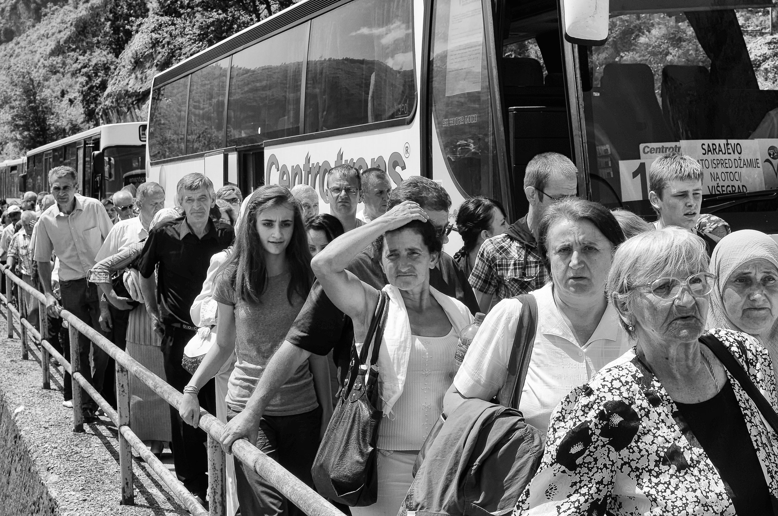 Muslims from all over Bosnia disembark buses in Visegrád to remember the 3,000 still missing from the genocide.