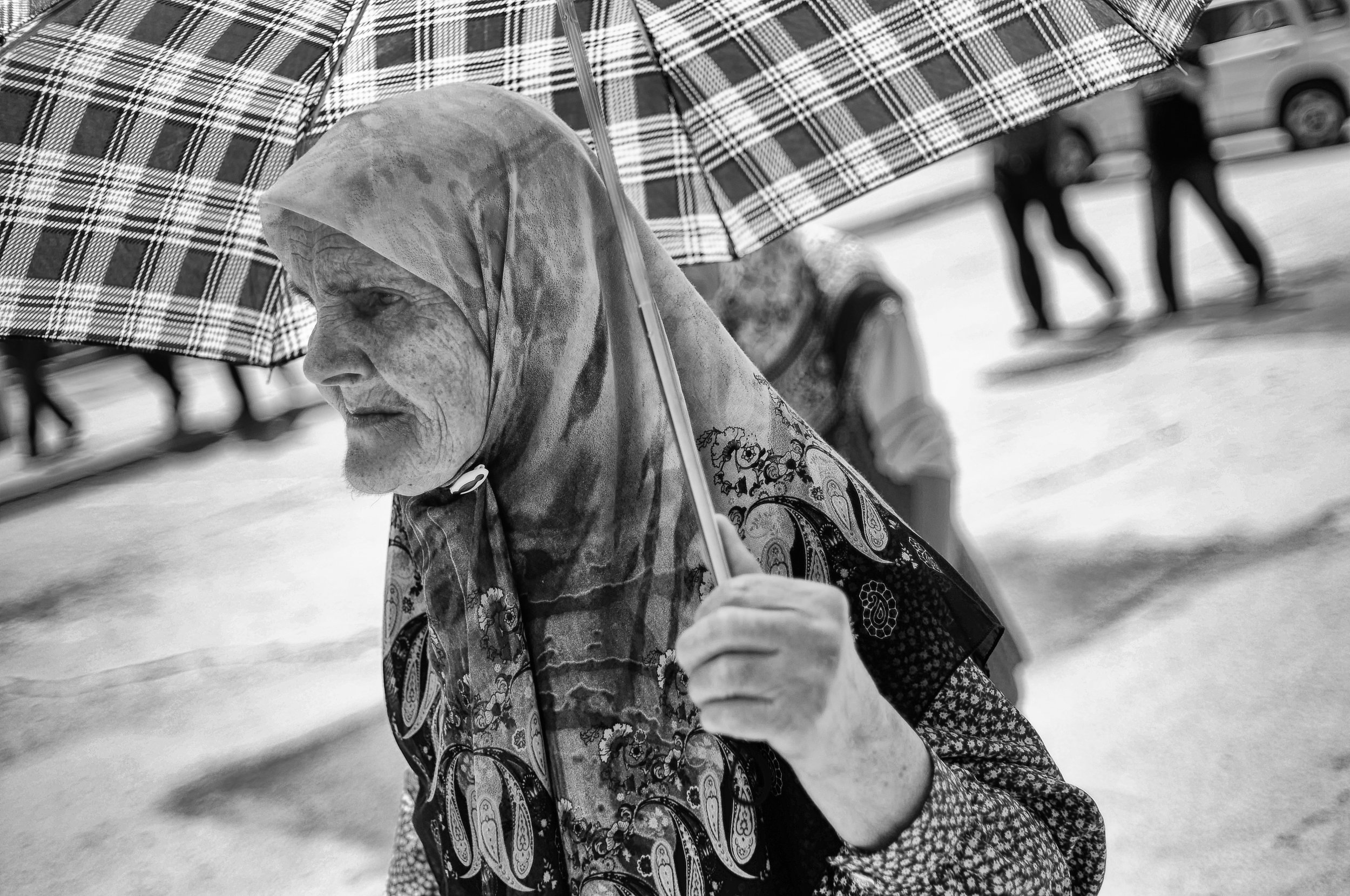 A Muslim woman walks through the Serb dominated town of Visegrád on her way to the funeral of 17 recently identified Muslims who were the victims of the region's 1992 genocide.