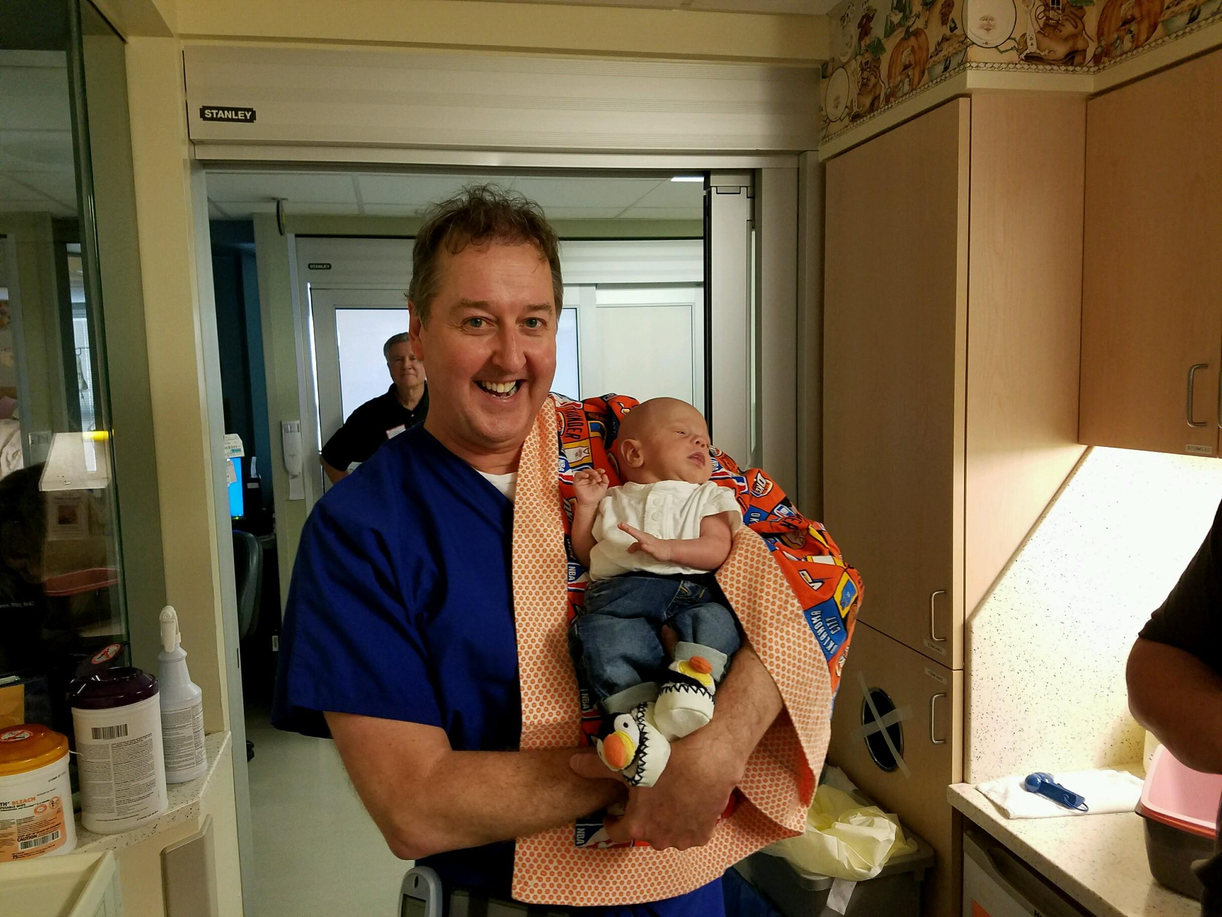 Conner with his neonatologist, Dr. Anderson, on discharge day! This was a bitter sweet day for sure.
