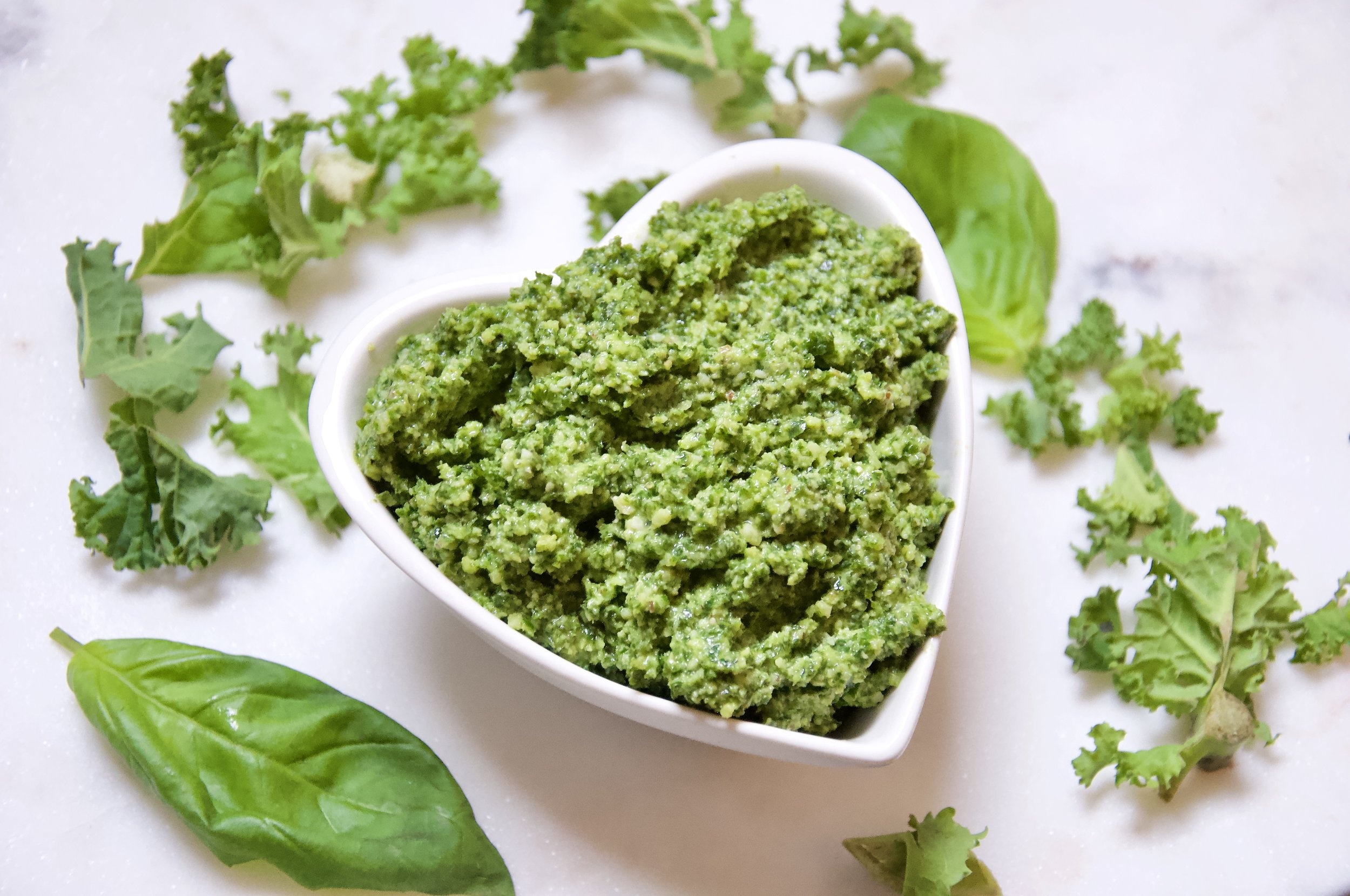 Emma's delicious Kale & Brazil Nut Pesto - enjoy it with pasta topped with some roasted peppers and tomatoes, or served with chicken, fish, in a panini or on potatoes.