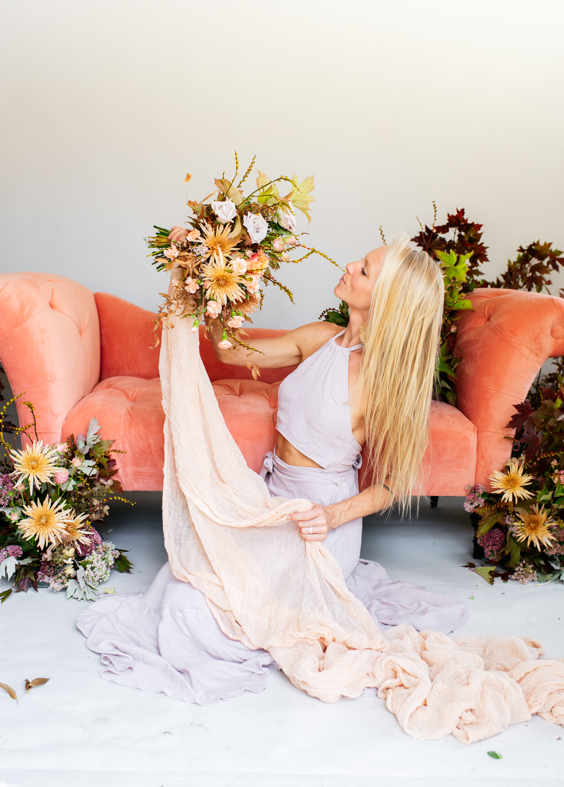 NECTAR + BLOOM | Samerica Studios Photography | autumnal floral installation with coral sofa + styling cloth by NECTAR + BLOOM