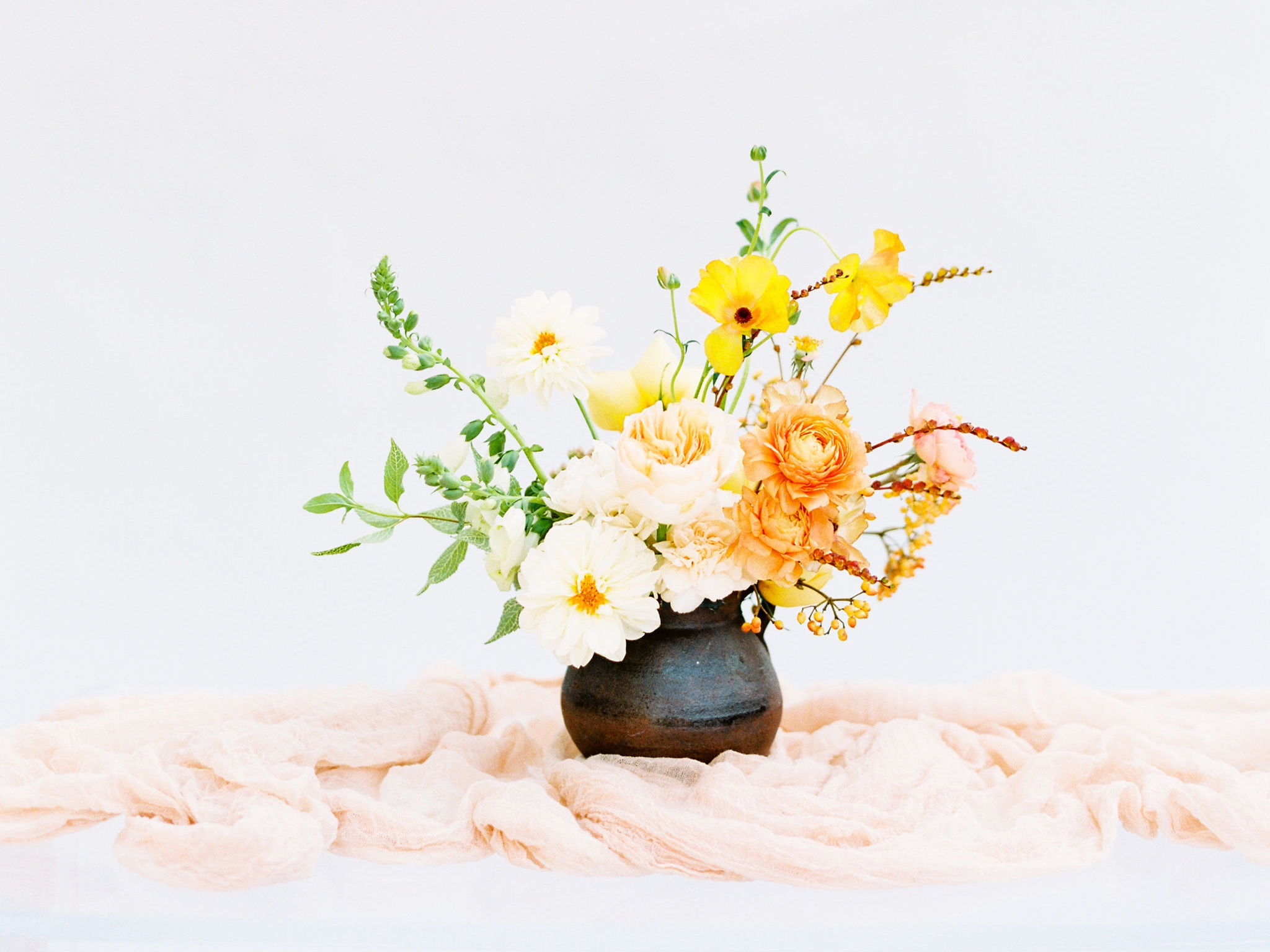 NECTAR + BLOOM | Eline Jacobine Photography | spring floral arrangement in ceramic vessel with peach styling cloth by NECTAR + BLOOM