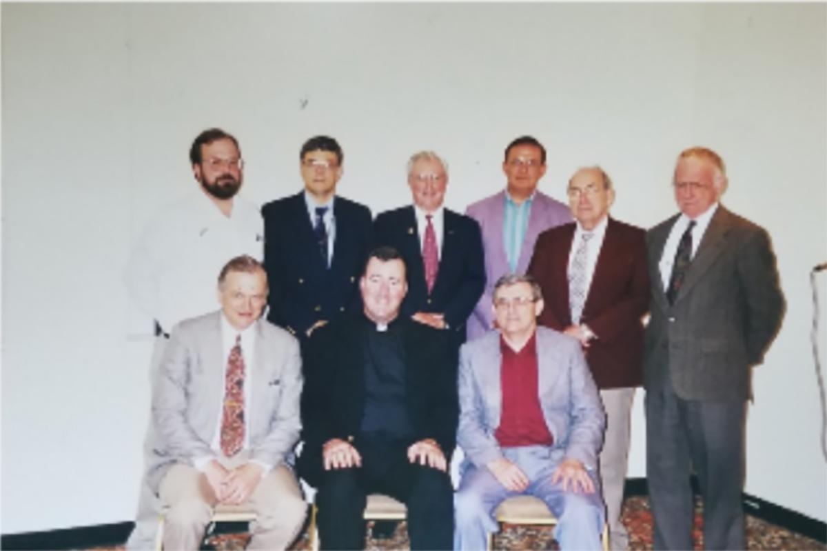 (Back Row) John Bruchowlski, Bill McCarthy, Bill Colliton, Bernard Aillig, Richard DeLaney, Joseph Evers. (Front Roy) Bud Andres, Fr. James Gould, Bill Hogan.