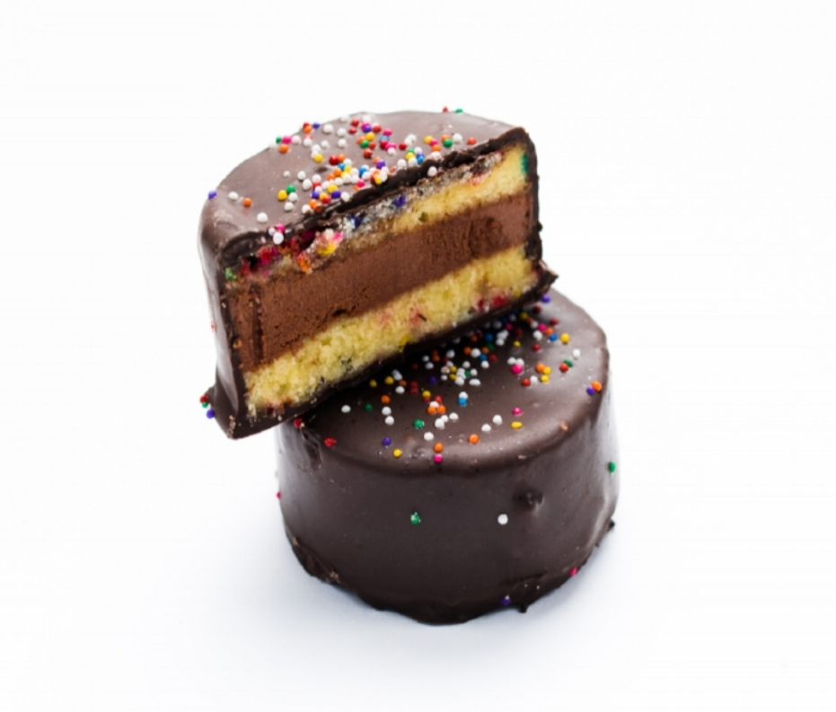 Funfetti   How does confetti get to be more fun? Make it edible. Sprinkle-infused vanilla cake encapsulates a dark chocolate cream filling, all dipped in dark chocolate and topped with sprinkles in this colorful contemporary addition to the Ring Ding ranks.