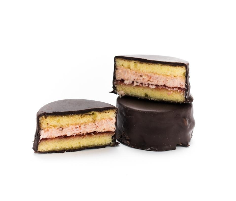 Chocolate-Covered Cherry   Fun fact: cherries are actually best in the middle. Tart cherry jam schmear and cherry cream filling sit at the center of vanilla cake dipped in dark chocolate. She got the way to move me, Cherry!