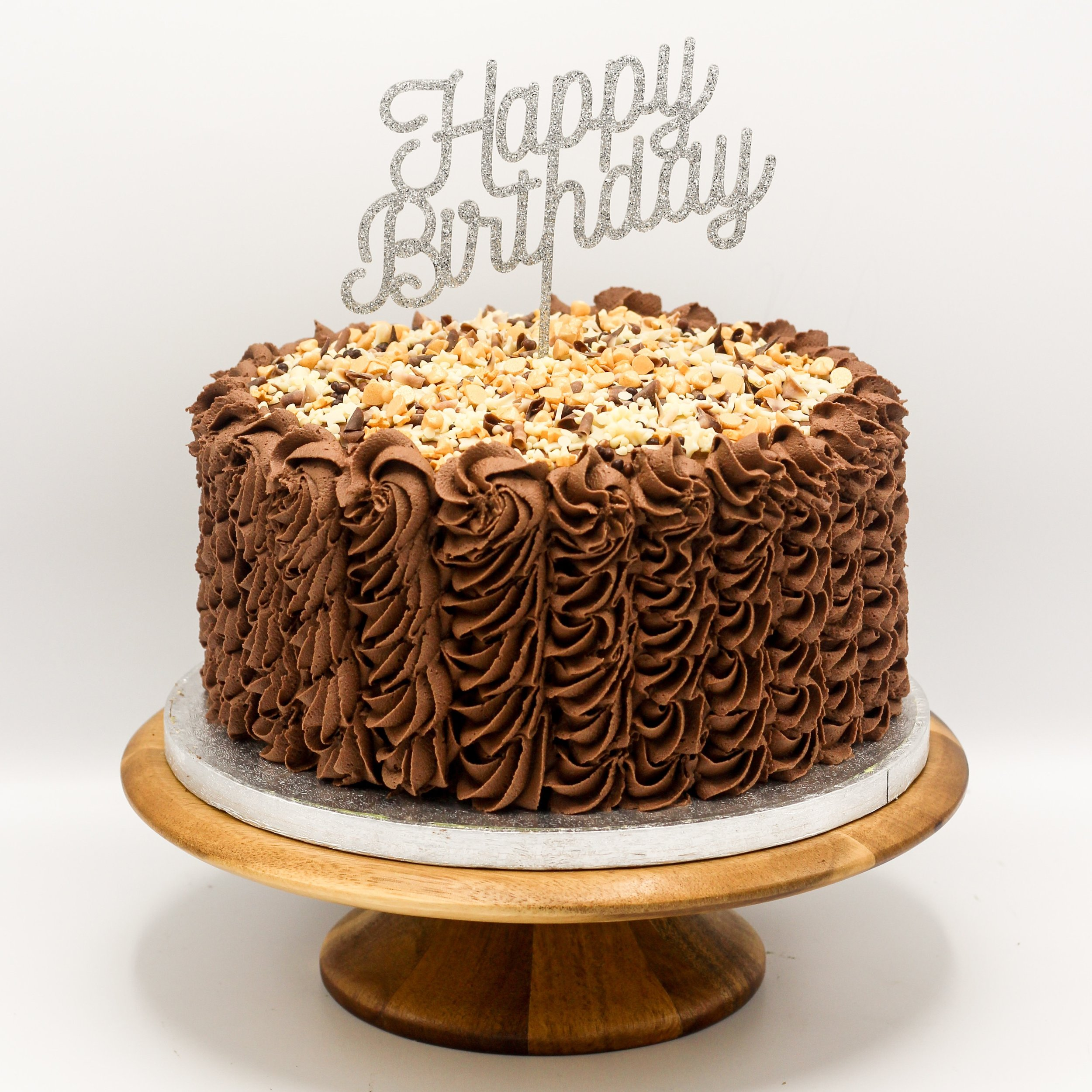"""Piped buttercream Cake - 6"""" from £328"""" from £3510"""" from £4112"""" from £48Available in a range of flavours and any colour combination.Buttercream cakes include a minimum 4 inch tall, four layer, sponge cake topped with sprinkles presented on a cake drum and stored in a lidded cake box."""