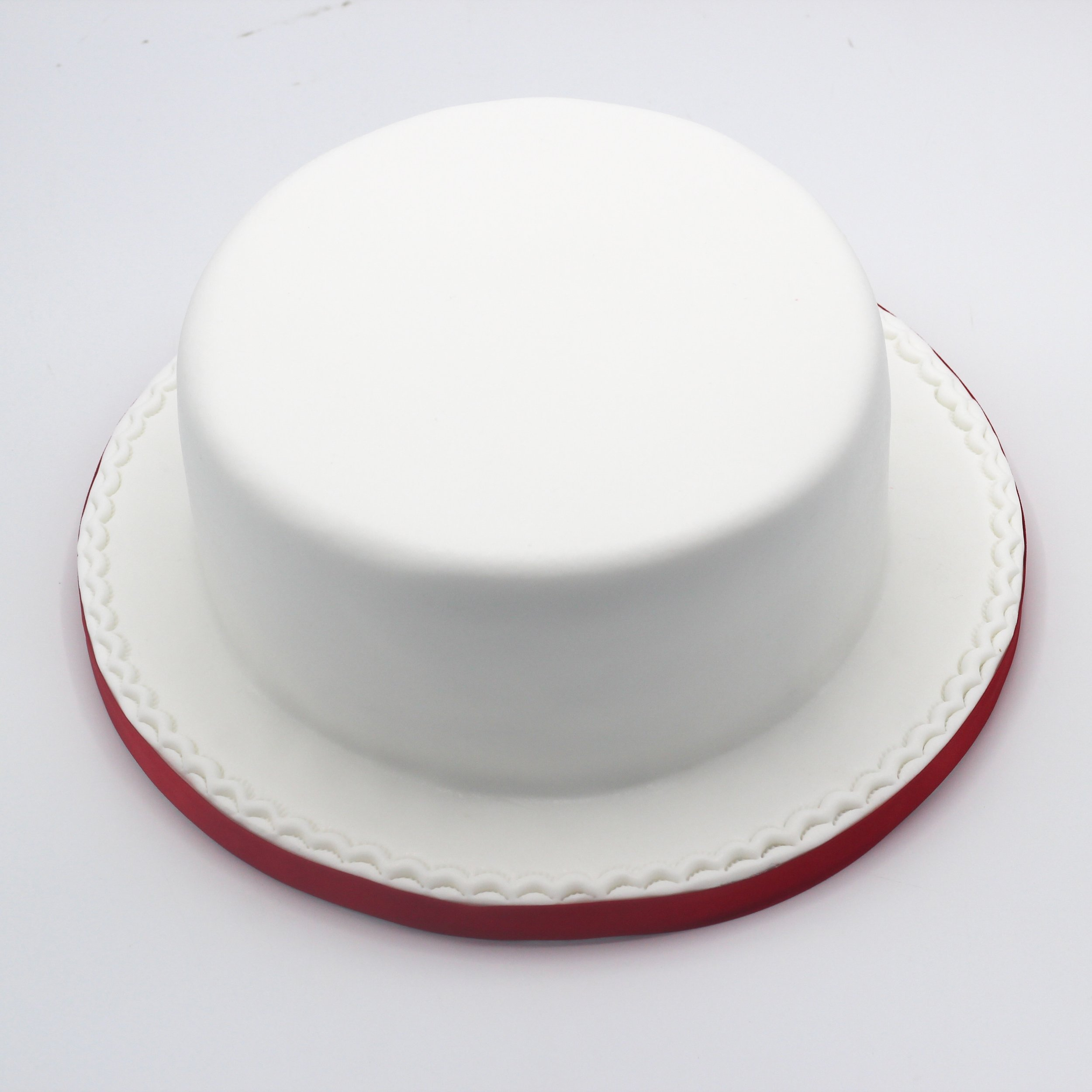 """Plain fondant sponge cake - 6"""" from £548"""" from £6010"""" from £6712"""" from £80The Nocturnal Baker uses luxury fondant brand Massa Ticino from Switzerland which not only tastes delicious but is also moisture and heat resistant so whatever the weather we can guarantee your cake will continue to stand proud!Plain fondant cakes include a minimum 4 inch tall, four layer, sponge cake on an iced and crimped drum, wrapped in ribbon and stored in a lidded cake box.Bespoke modelled features are quoted as extra."""