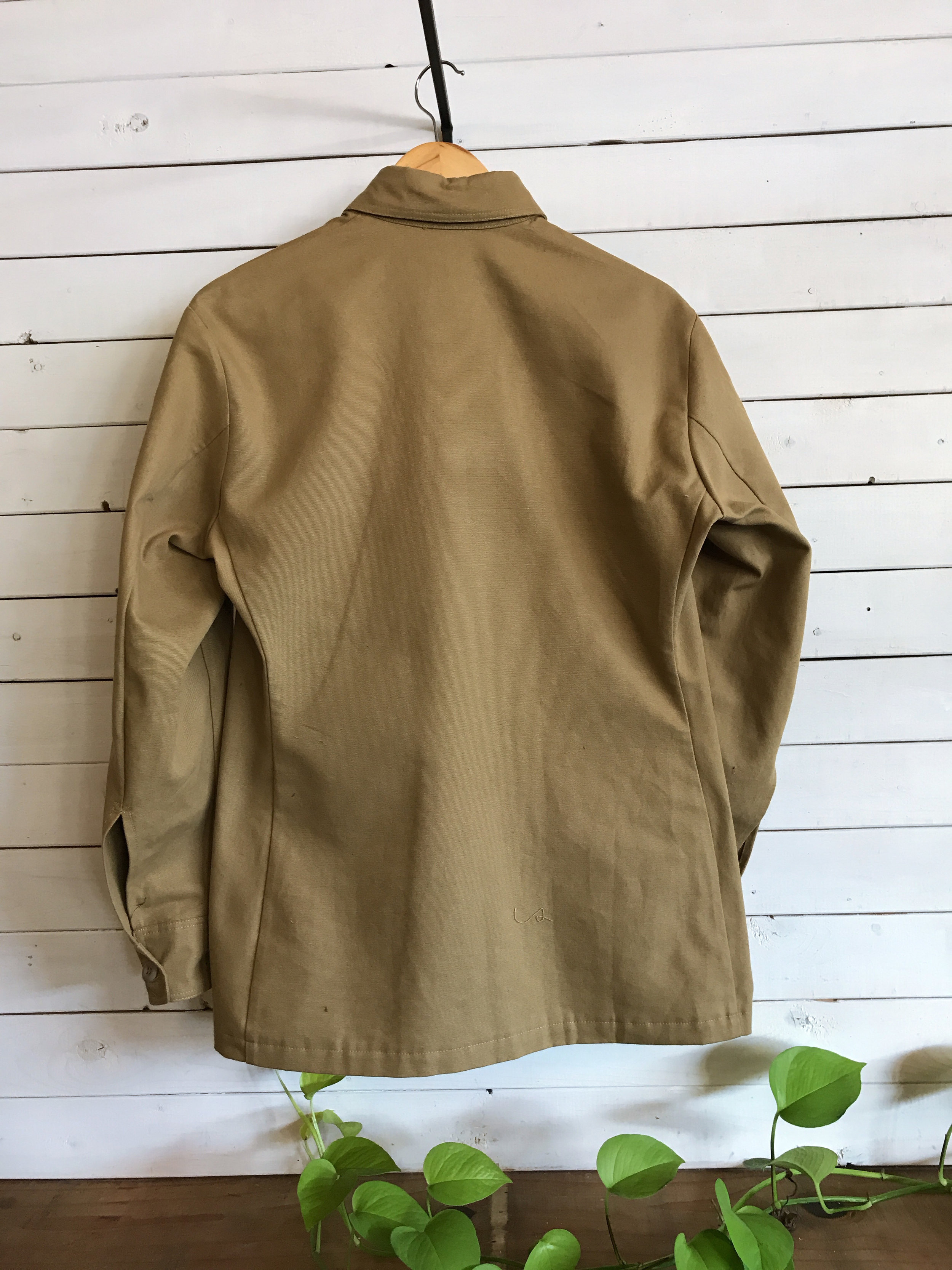 Back - Back view of tan jacket