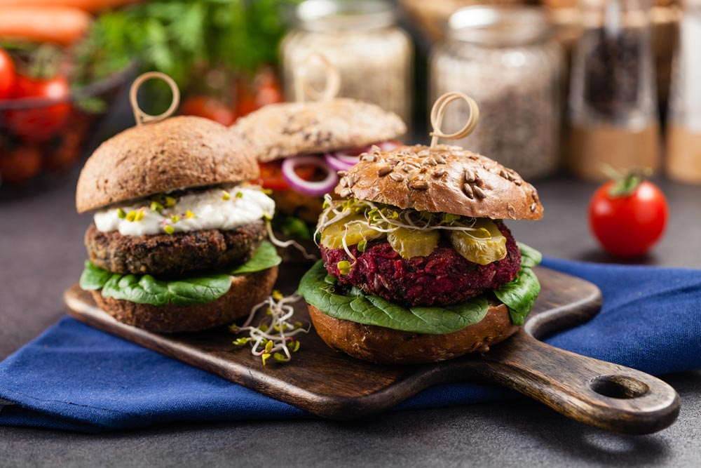 veggie-burgers-three-on-wood-board.jpg