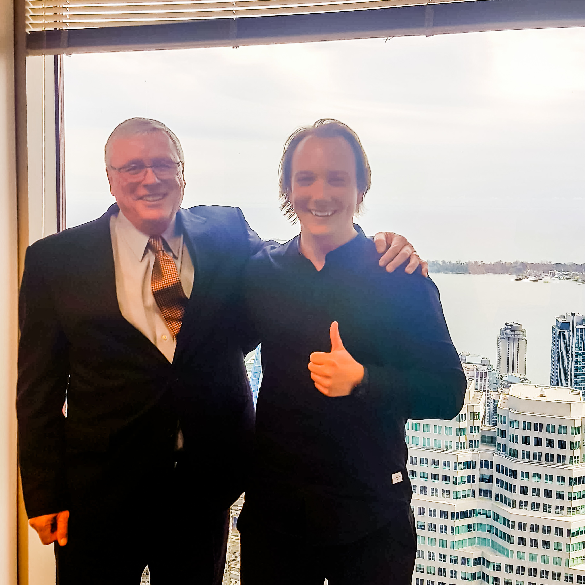 GetintheLoop CEO Matt Crowell (right) with former Canadian Western Bank CEO Larry Pollock, who helped developed the in-house financing program for GetintheLoop Local.