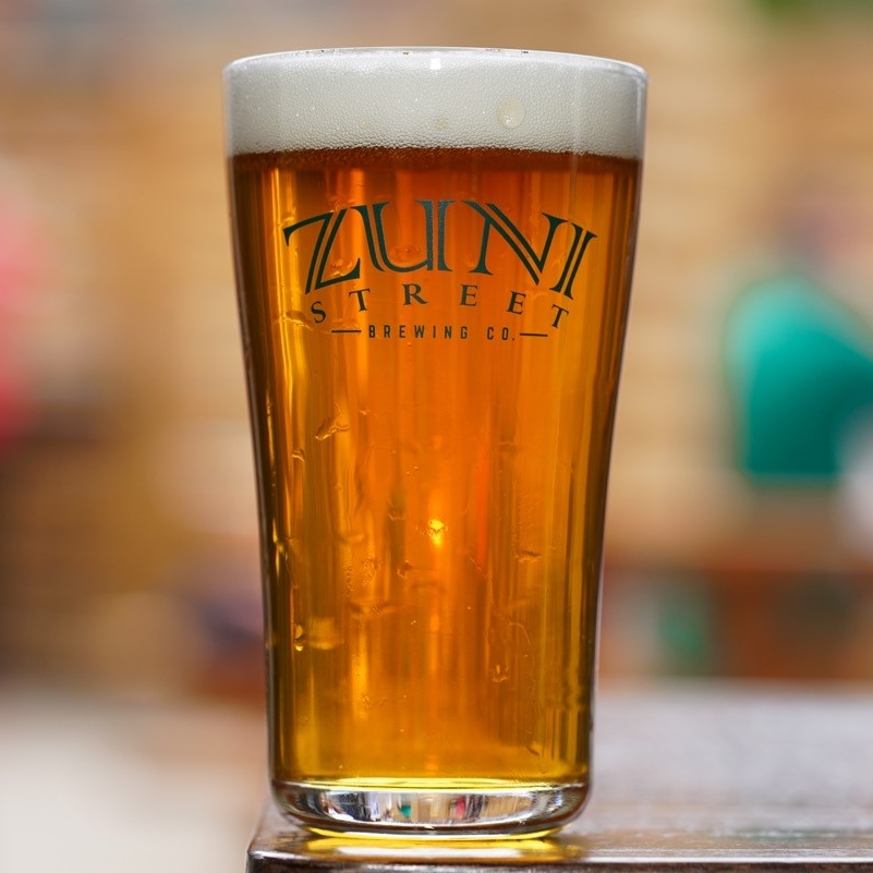 ZUNI STREET IPA ABV: 7.7% IBU: 45 A bright, hoppy offering, packed with flavors of citrus and tropical fruit. Full bodied and smooth, this beer is well balanced and drinkable to no end.
