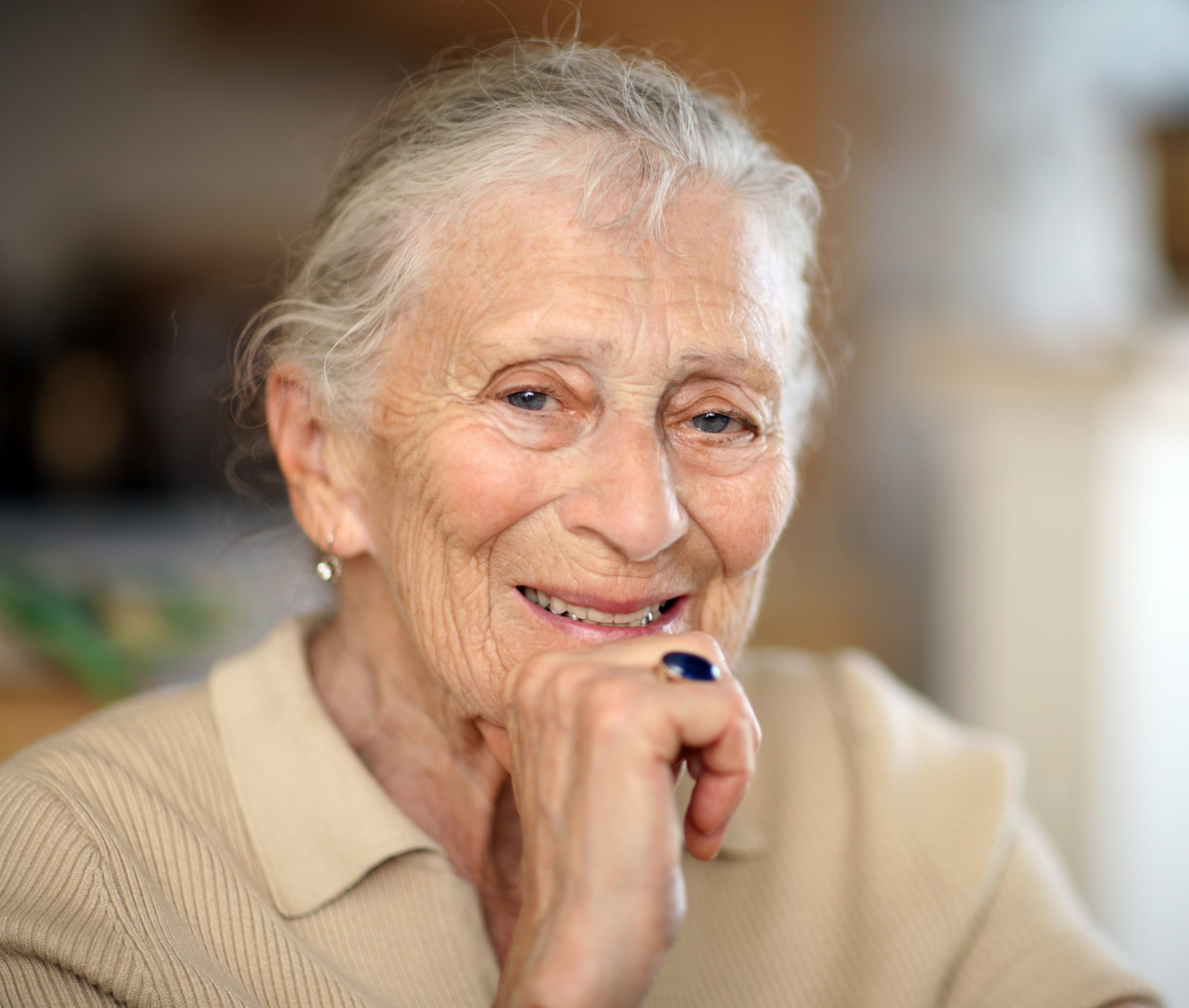 Senior woman with her hand at her chin