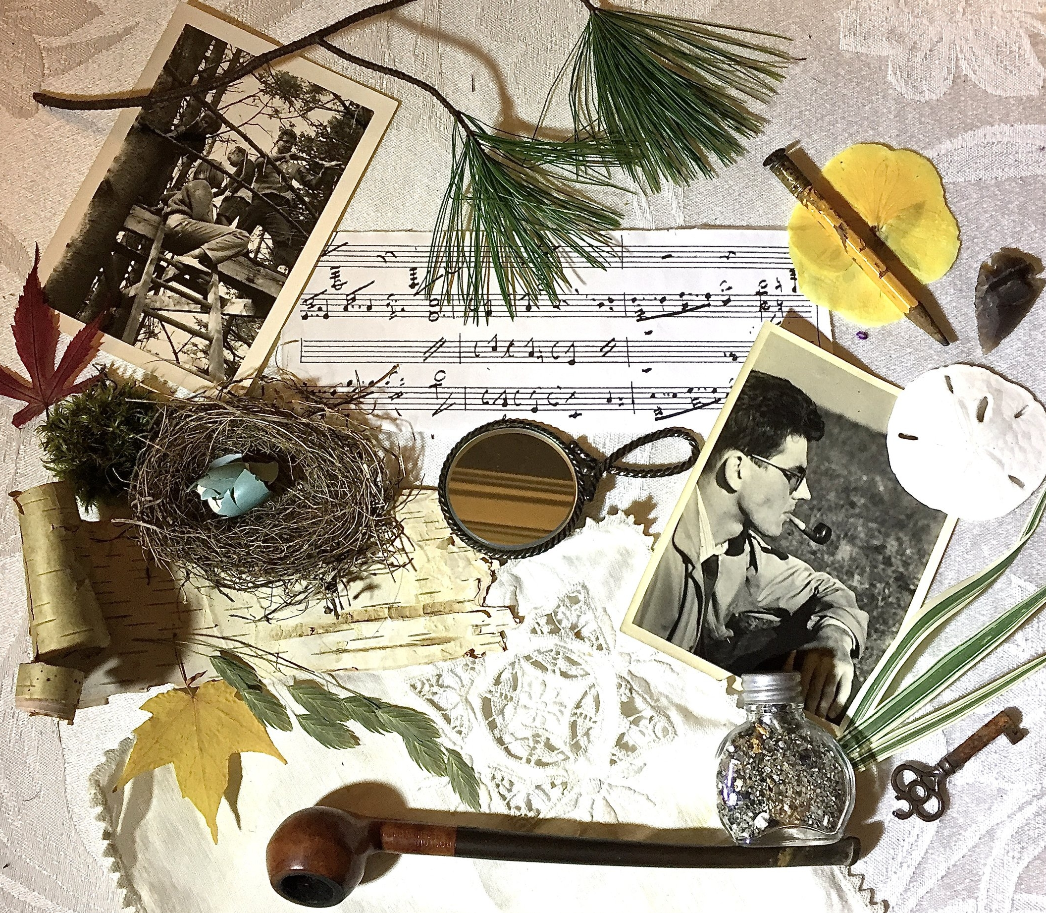 Collage wh memorabilia and photos, bird's nest, pipe, key, old pencil