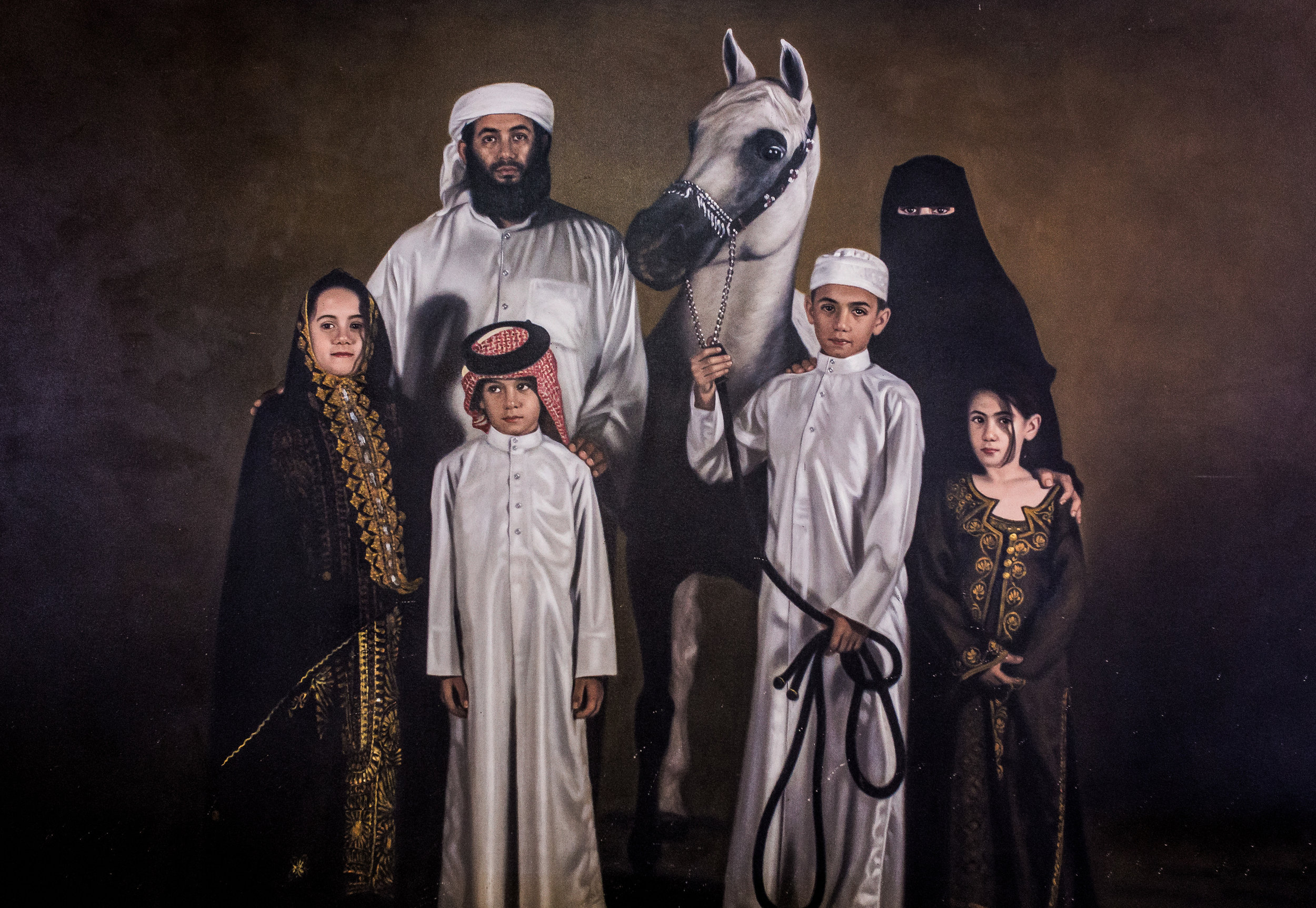 Bin Laden Family Portrait. Yep, my Photographer found a family painting. Crazy right? No we didn't buy it. NEVER!! But he took a pic of it hanging on the wall. Crazy Right?