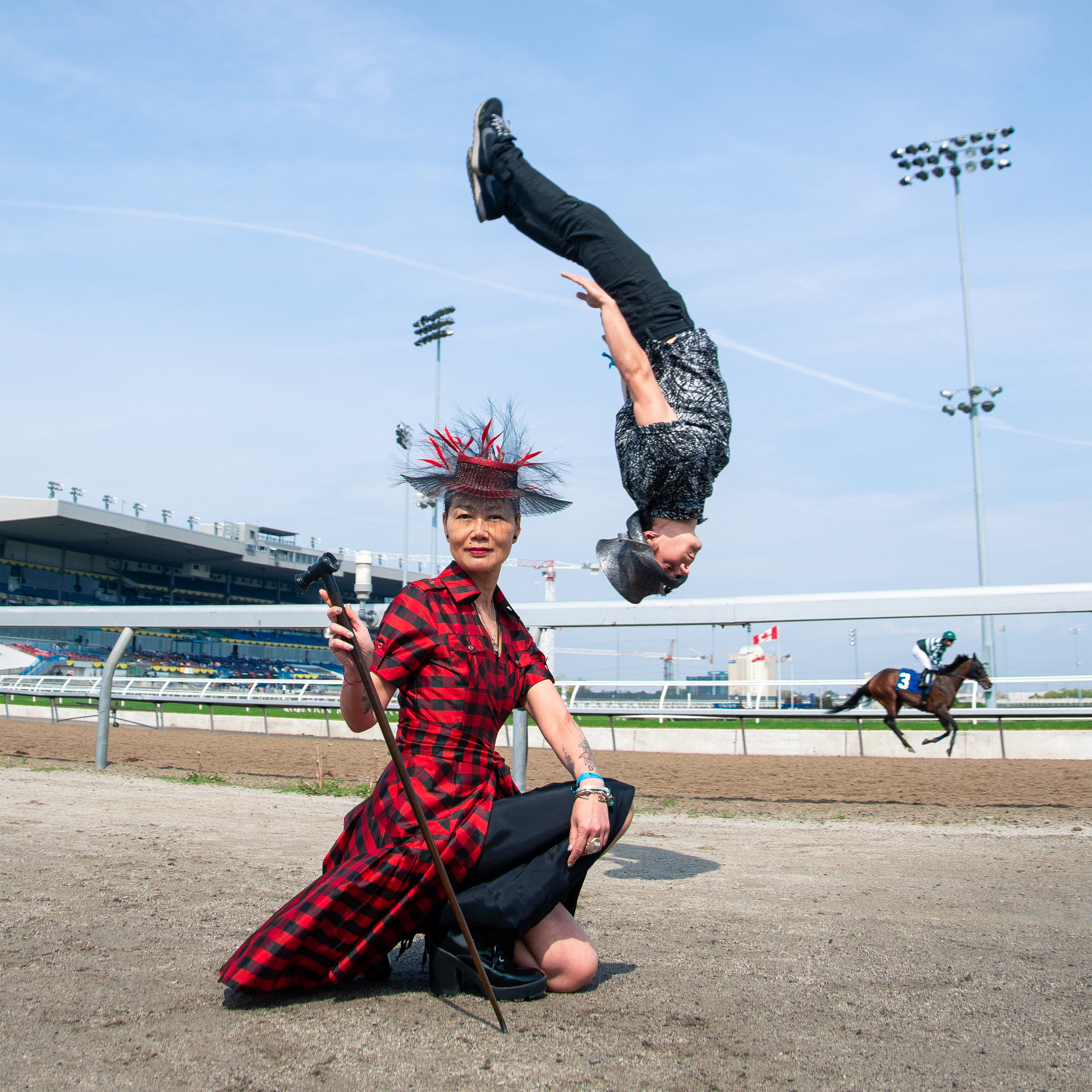 Jay Cheng of Jaycow Millinery at Greenwood Stakes, Woodbine Racetrack with Acrobat Alex Trickoso. Photograph by Jesús Maza Piñero.