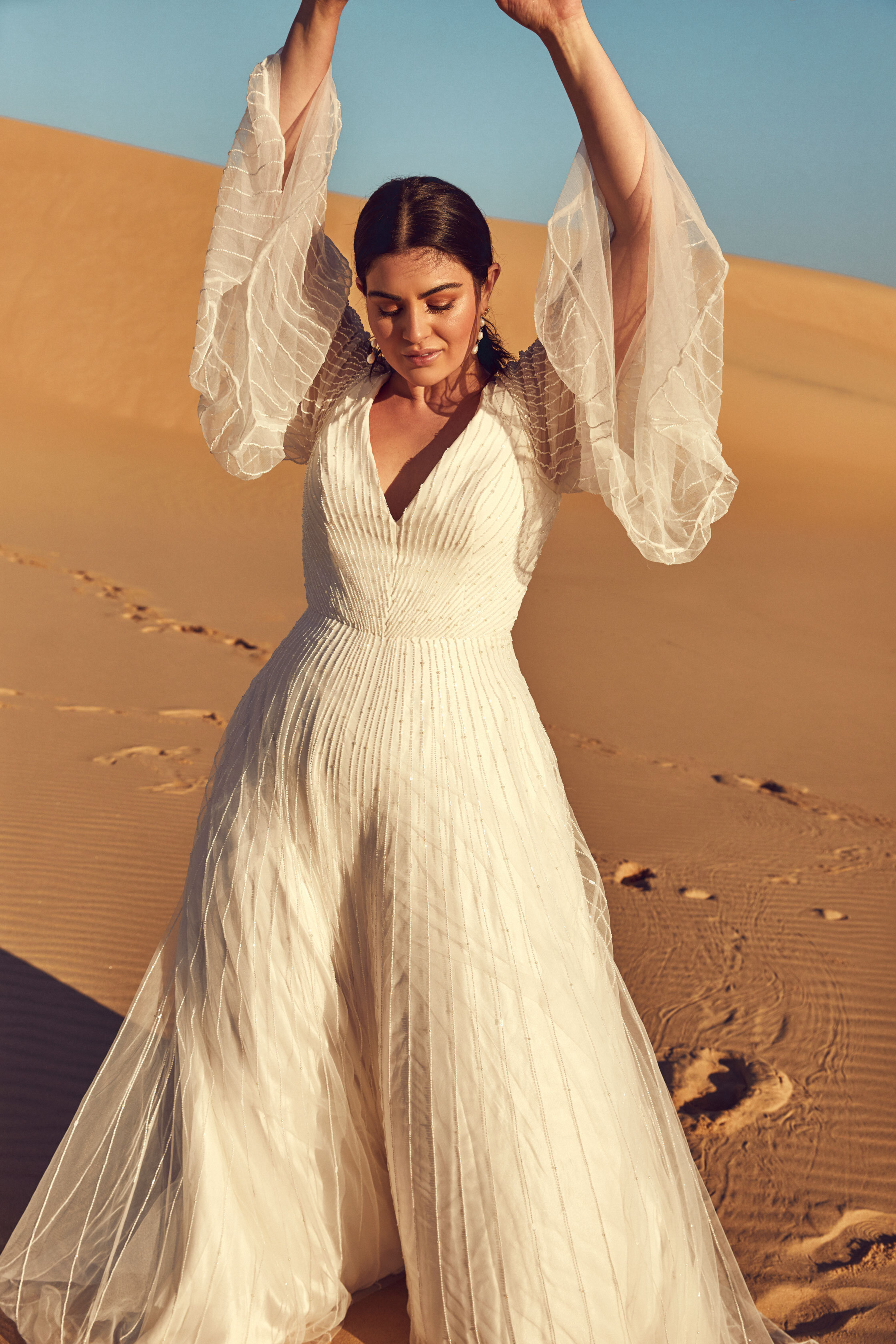 CURVE - View the capsule of specially designed gowns from the Desert Rose Collection HERE