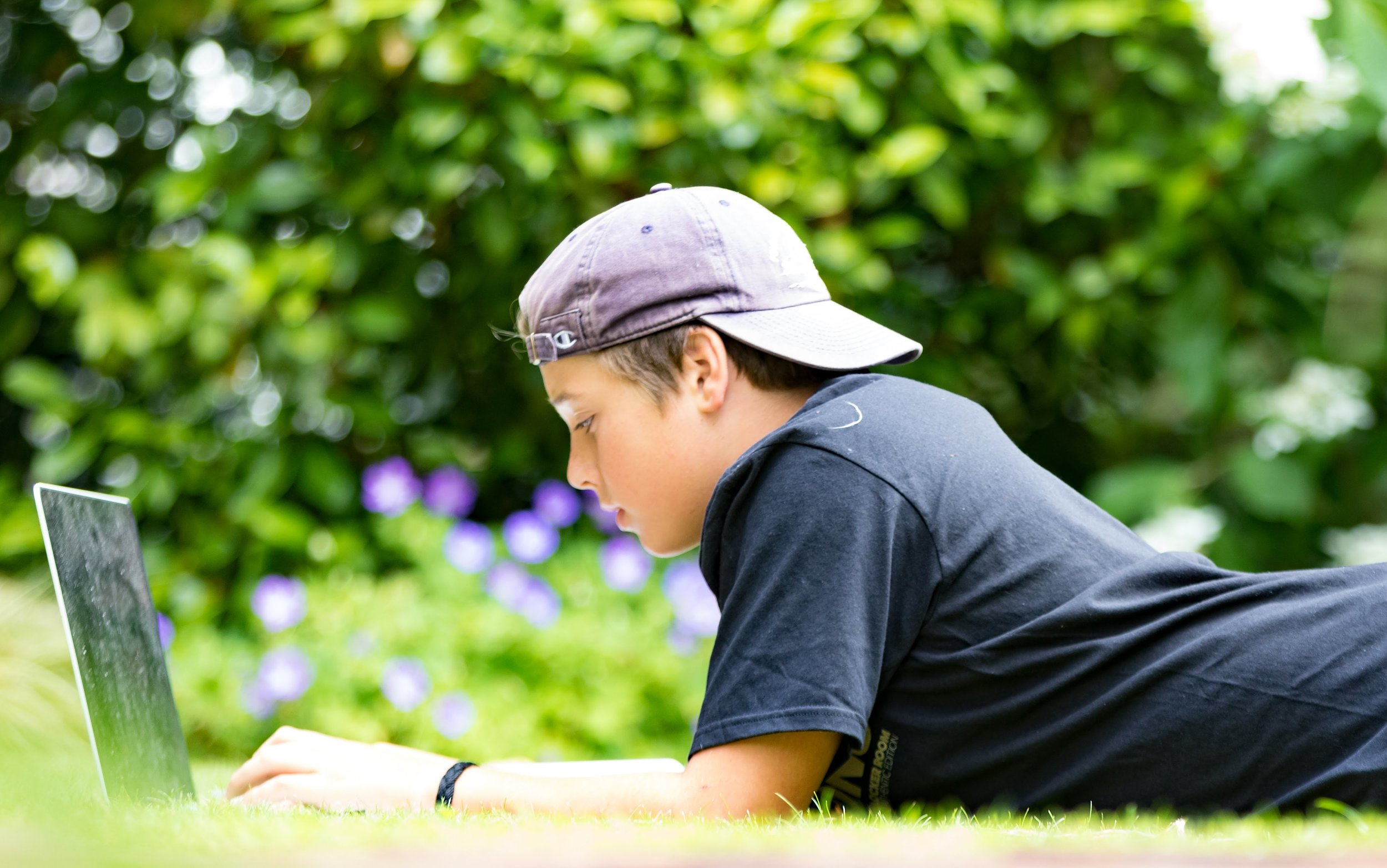 Boy writing in grass.jpeg