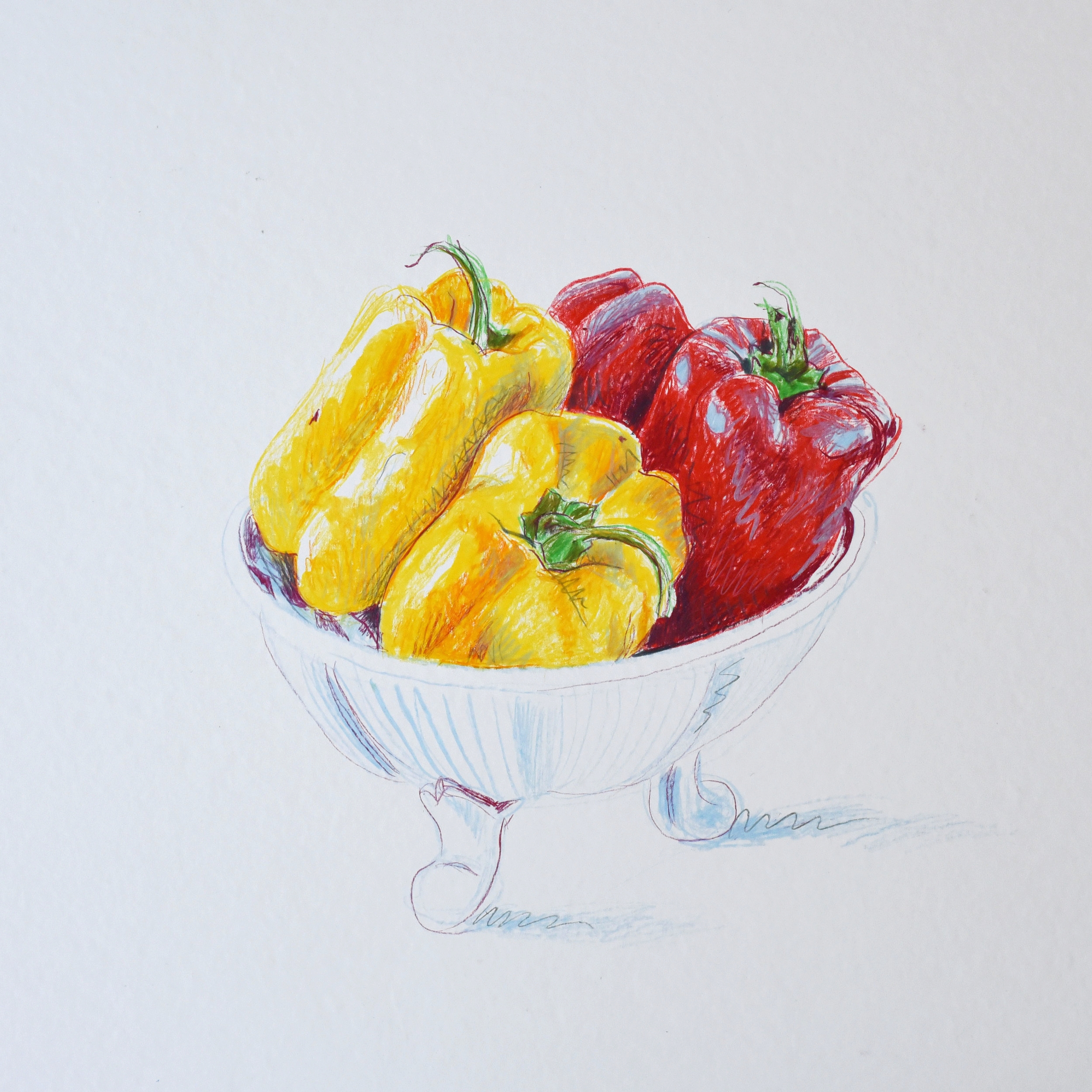 Still life of red and yellow peppers in a bowl