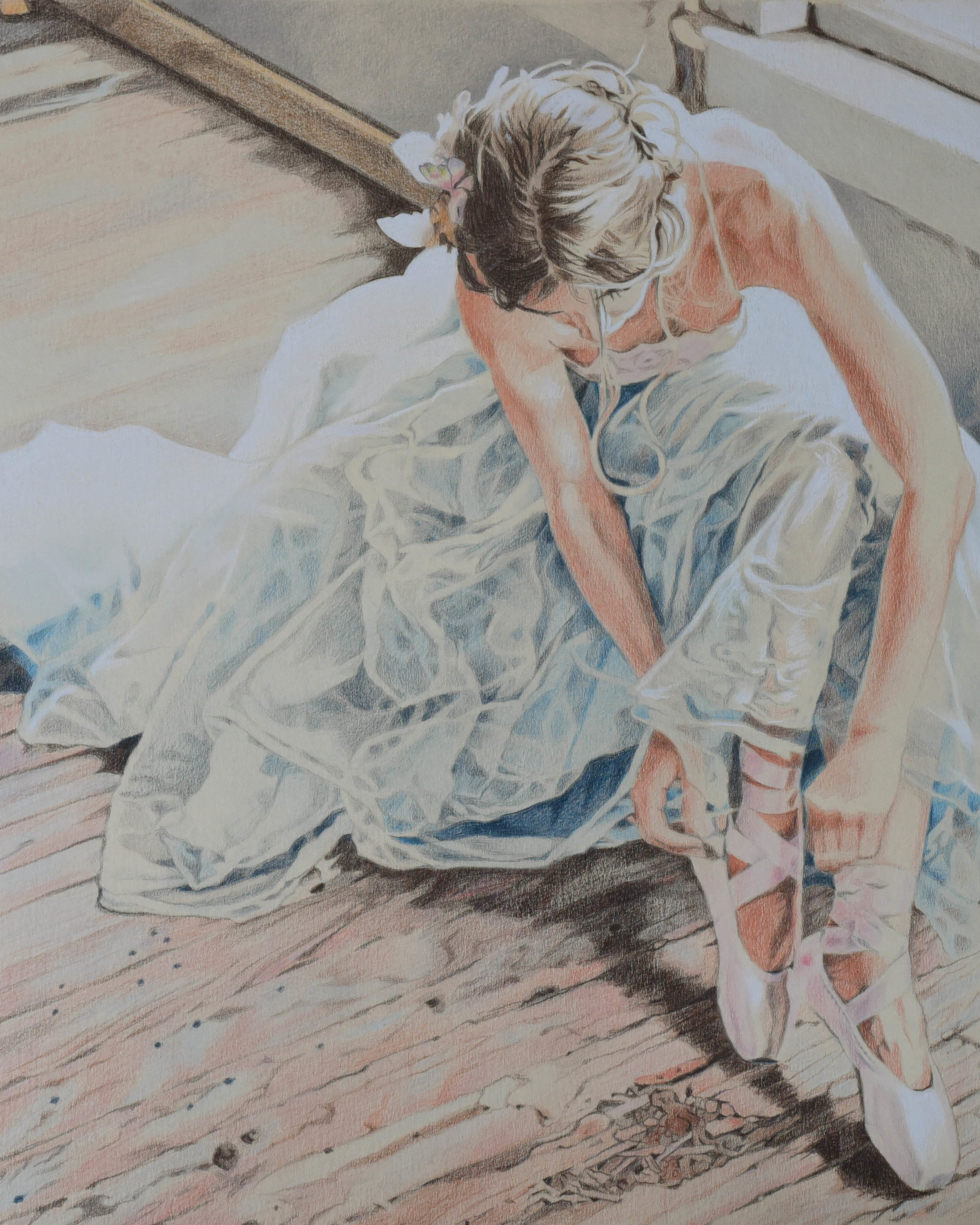 Colour pencil portrait of a ballerina in pointe shoes wearing a tutu.