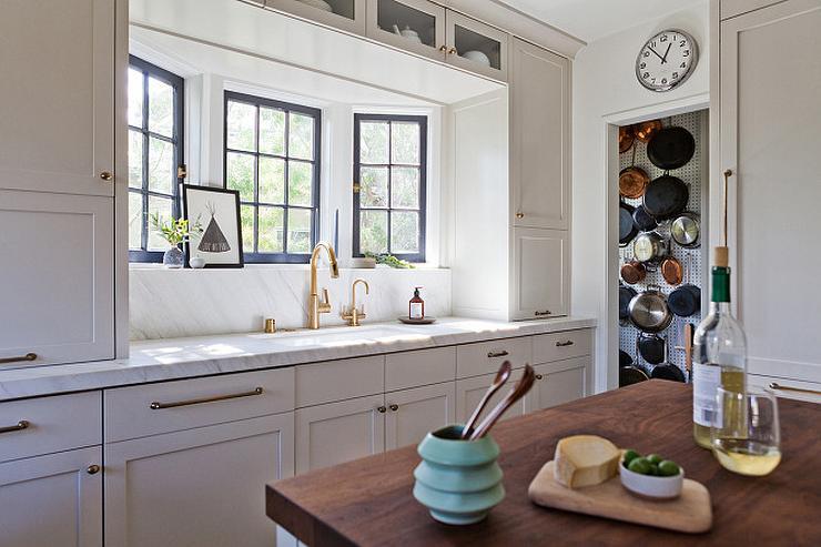 bay-window-kitchen-sink-light-grey-shaker-cabinets-brass-hardware.jpg