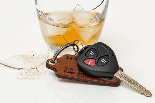 Car keys next to liquor