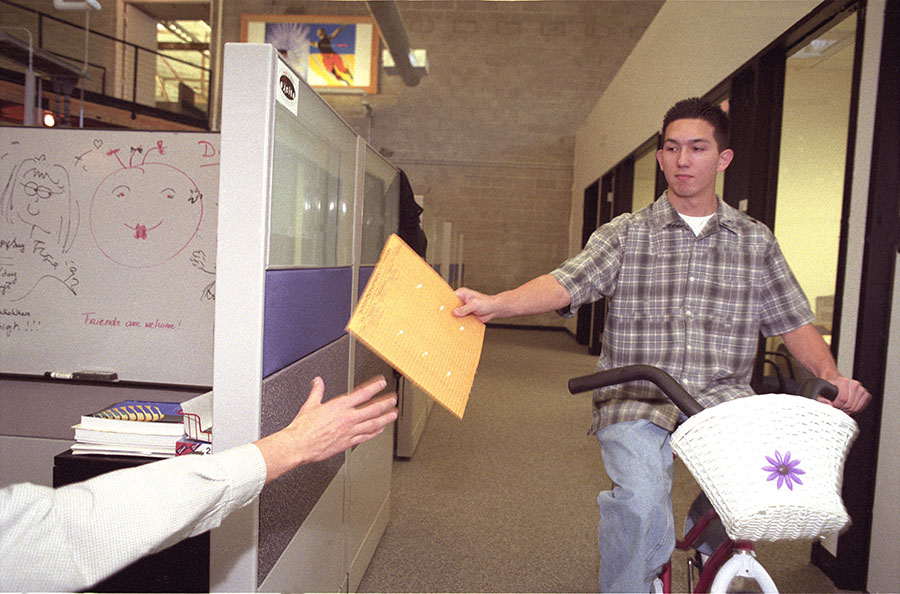 Internal mail being delivered at Excite's massive warehouse offices back in 1997.